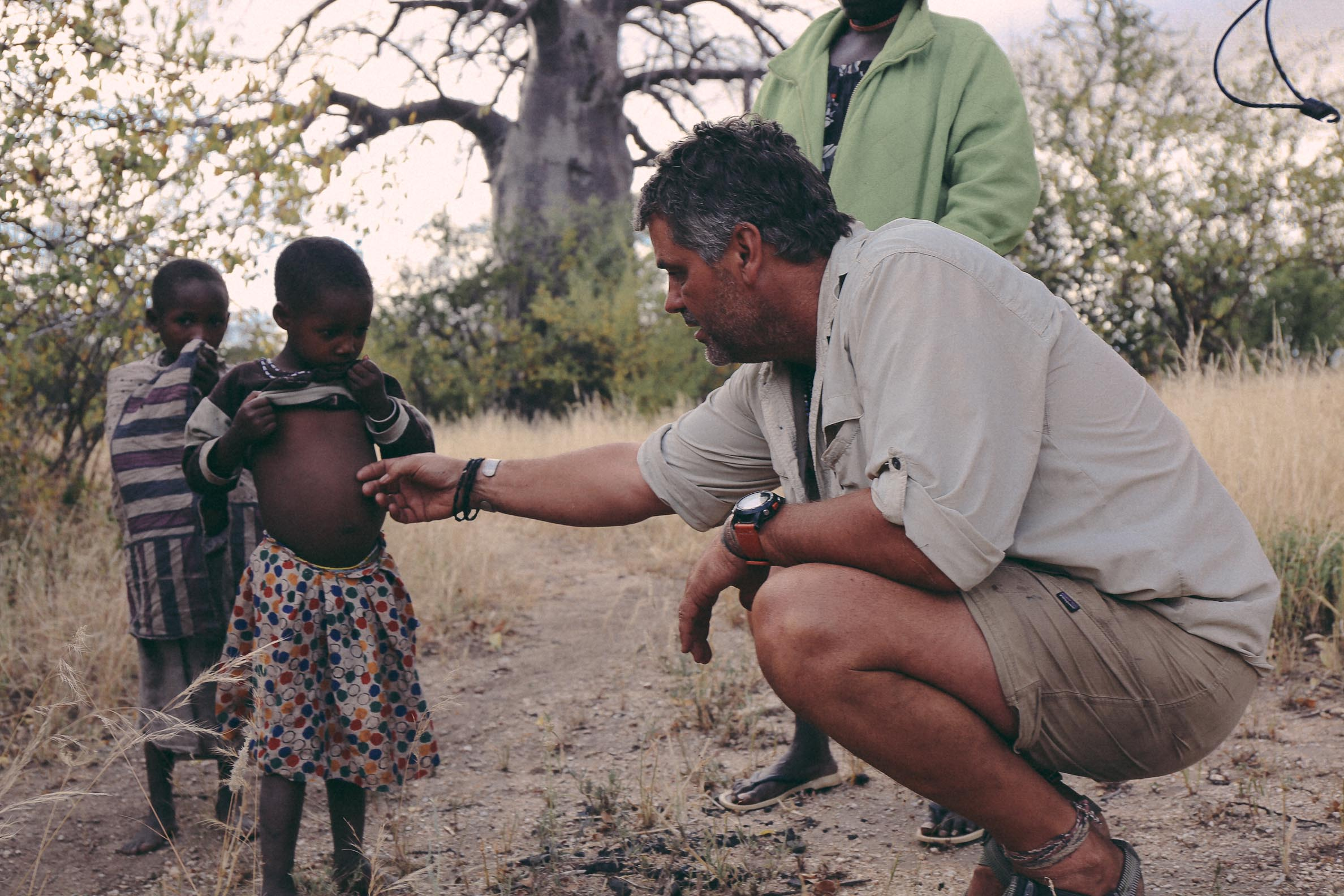 Jeff Leach with a Hadza child, Tanzania.