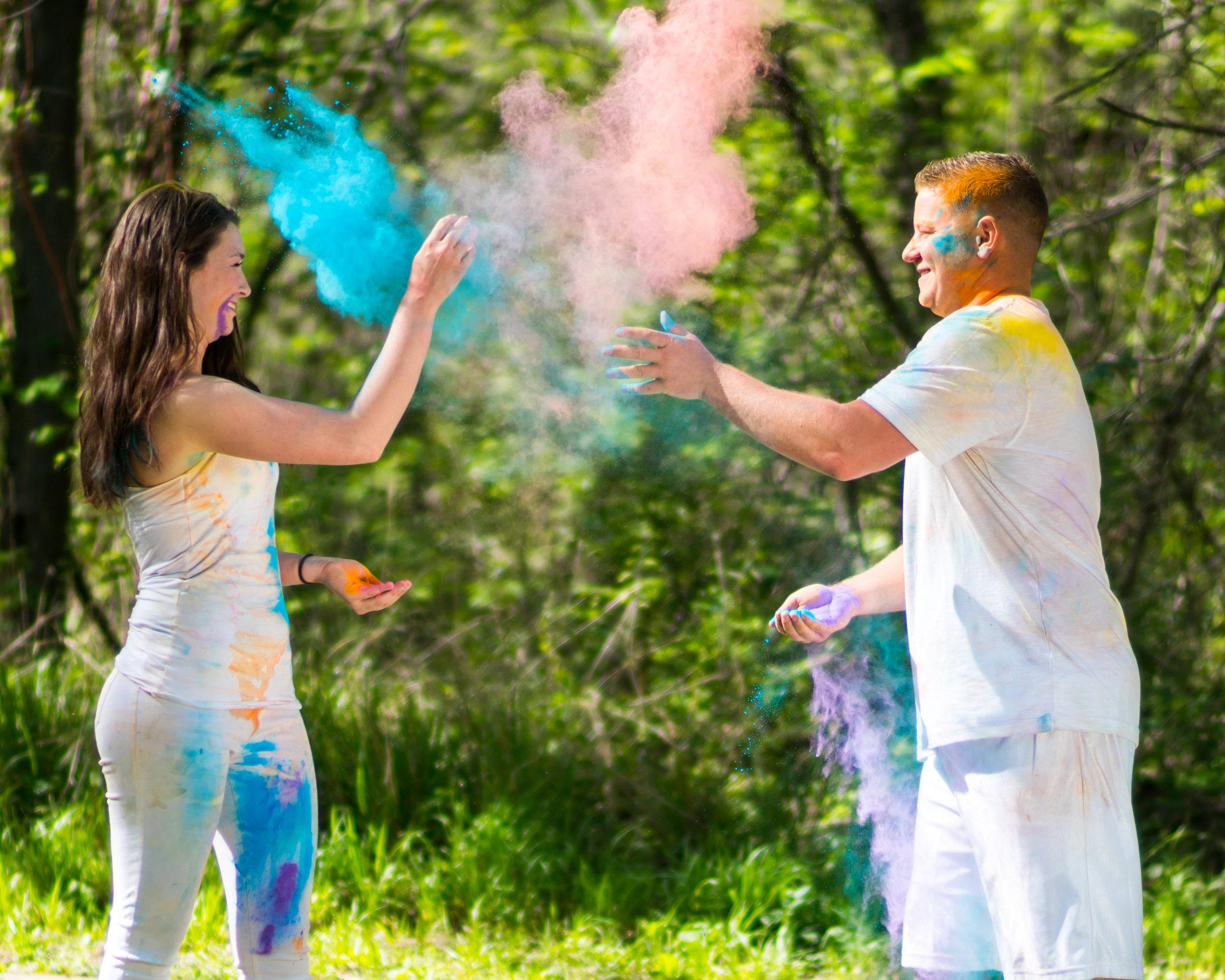 Dusti and Evan in a heated color powder fight, following the 2017 Dallas Color Run, photo by AJ Miragliotta