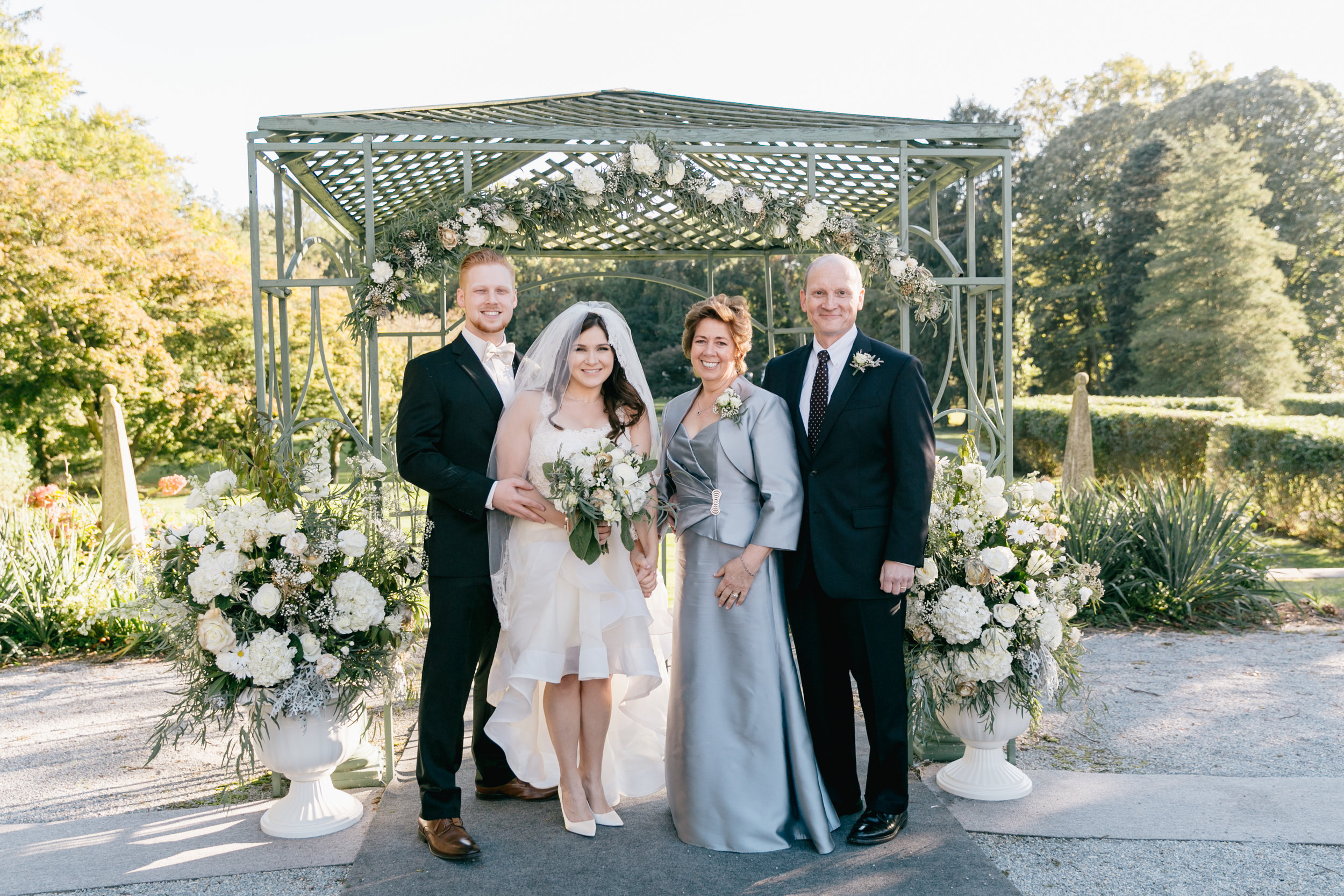 The arbor is one of our favorite pieces to work with at Greystone, and the large altarpiece arrangements are a tasteful way to frame the ceremony.