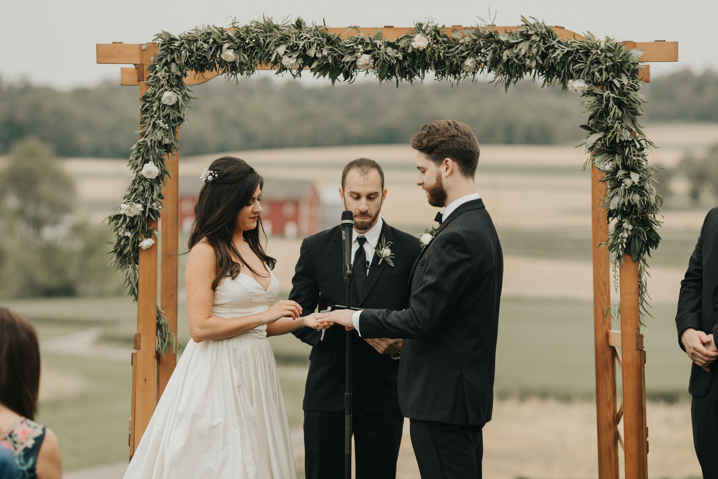 A simple green and white garland can be the perfect accent to frame your ceremony.