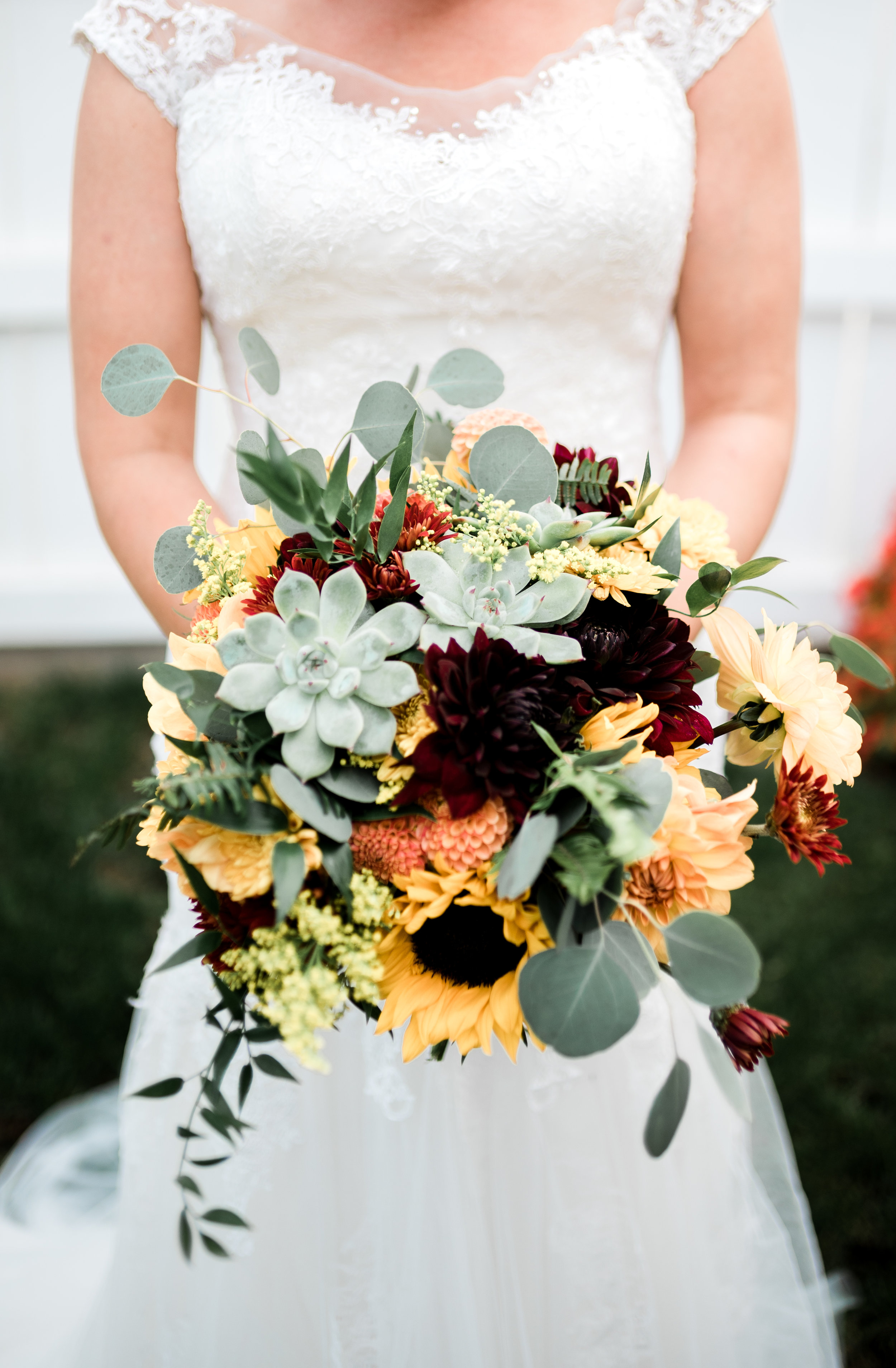 The Bride's Bouquet: Dahlias, Mums, Sunflowers, and Succulents for focals, Solidago as a filler, and Eucalyptus, Italian Ruscus, and Ferns for greens