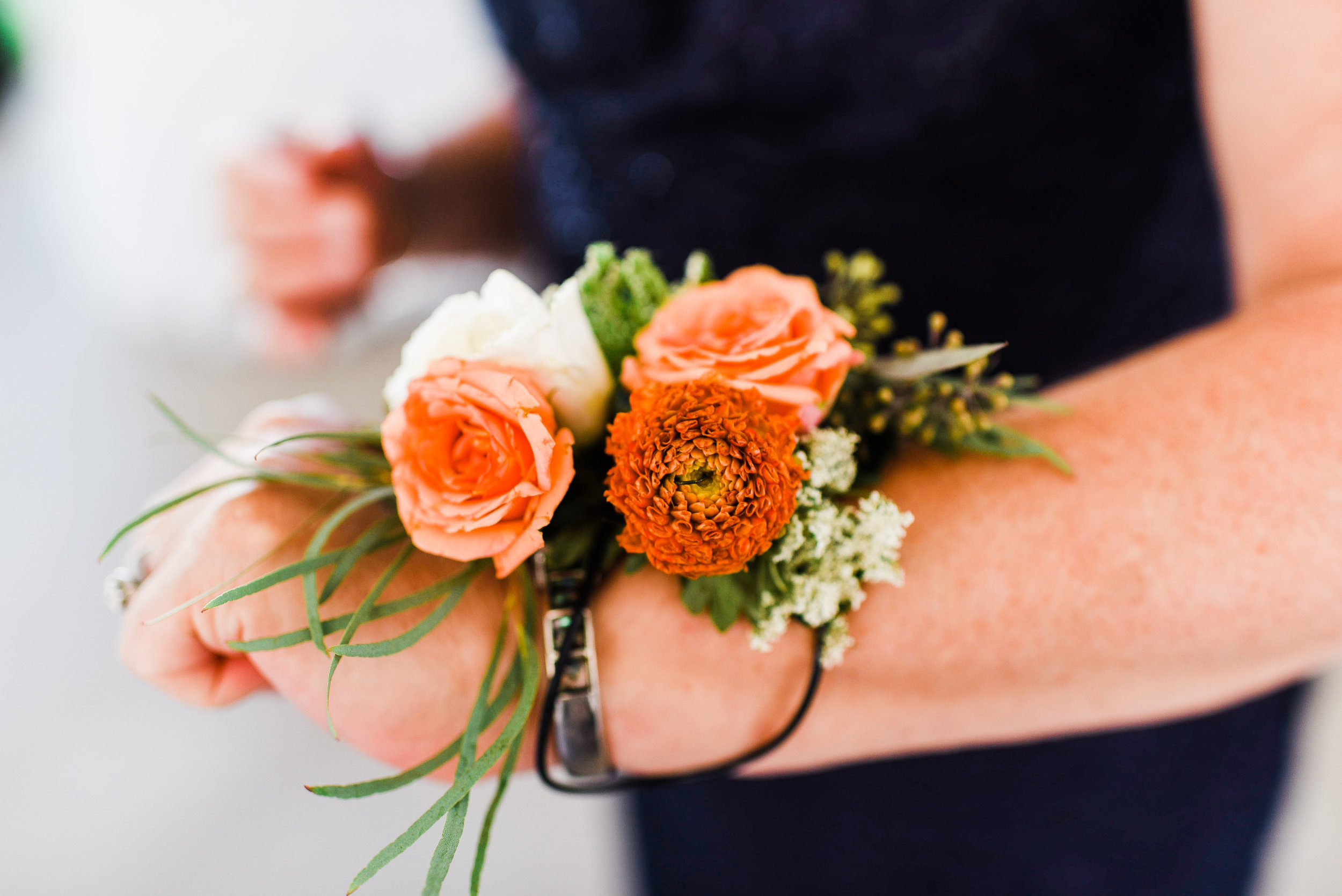 Wrist Corsages are the perfect pop of color for moms or any honorary women to wear.