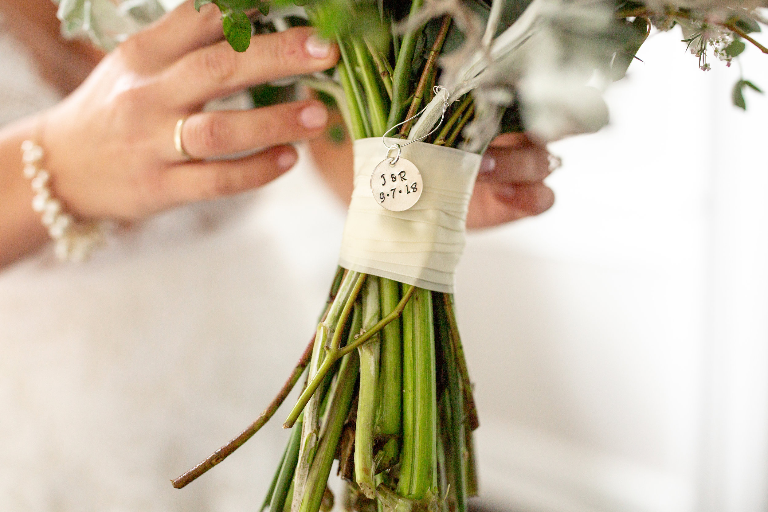 "We like to add this little charm as a personal touch to our bride's bouquets. O Jolie Designs custom stamps these charms with the bride and groom's initials and wedding date and we wrap it around the back of your bouquet as a special keepsake to say, ""Thank you for choosing us to be part of your wedding day!"""