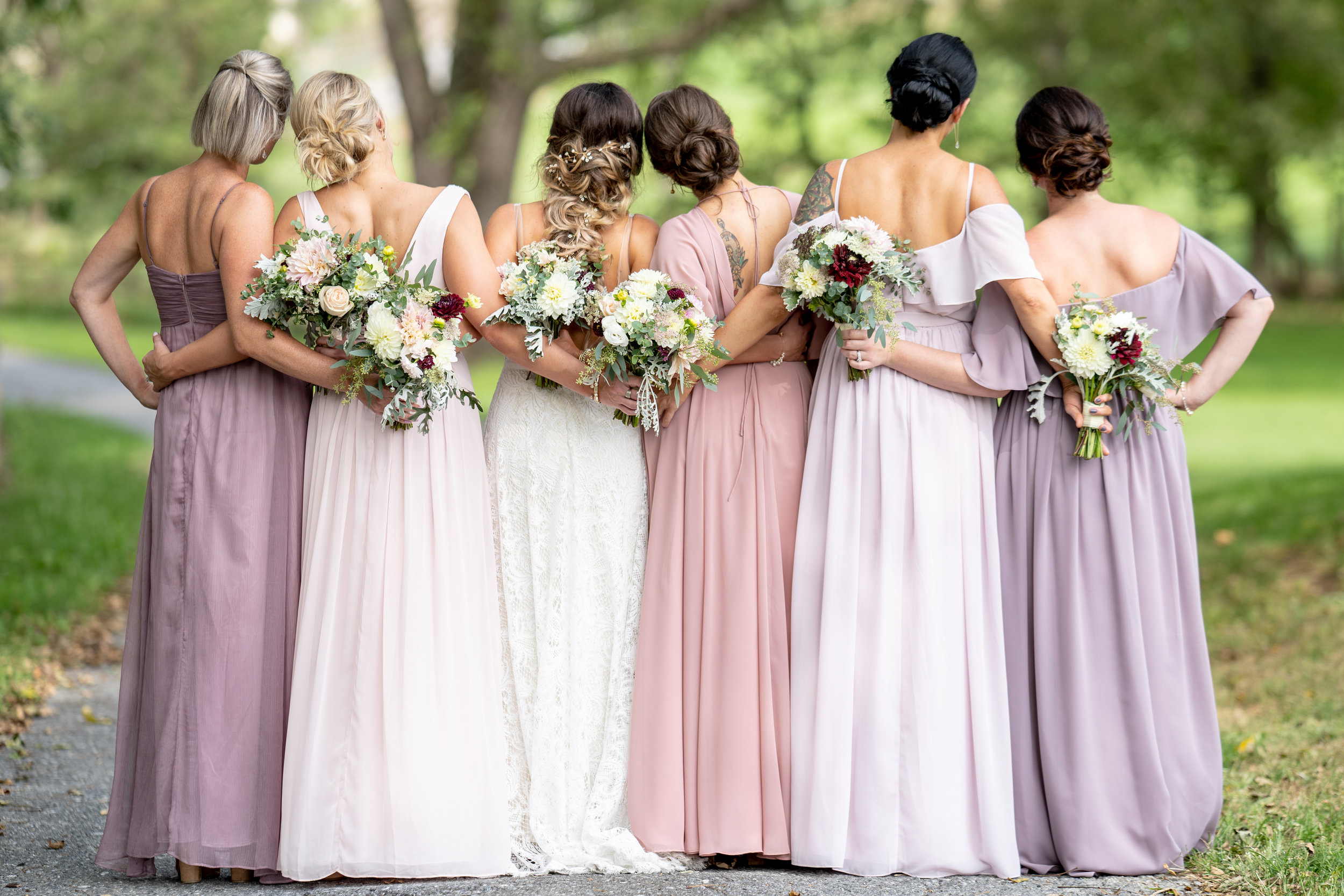 We love how the long light colored dresses really make the flowers and especially the deep red dahlias pop!