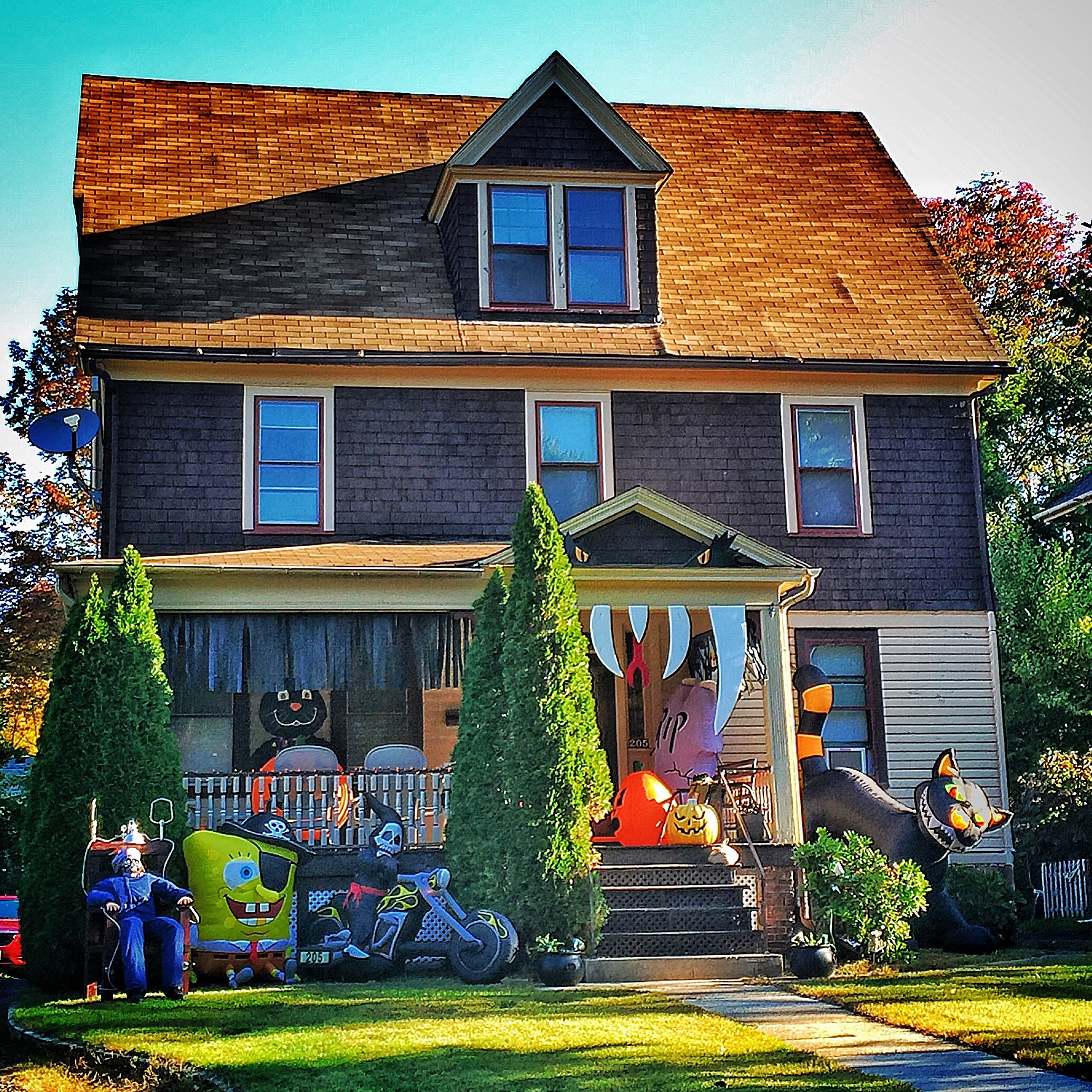 This is a crazy haunted house on Halloween with lines of kids from all over town!
