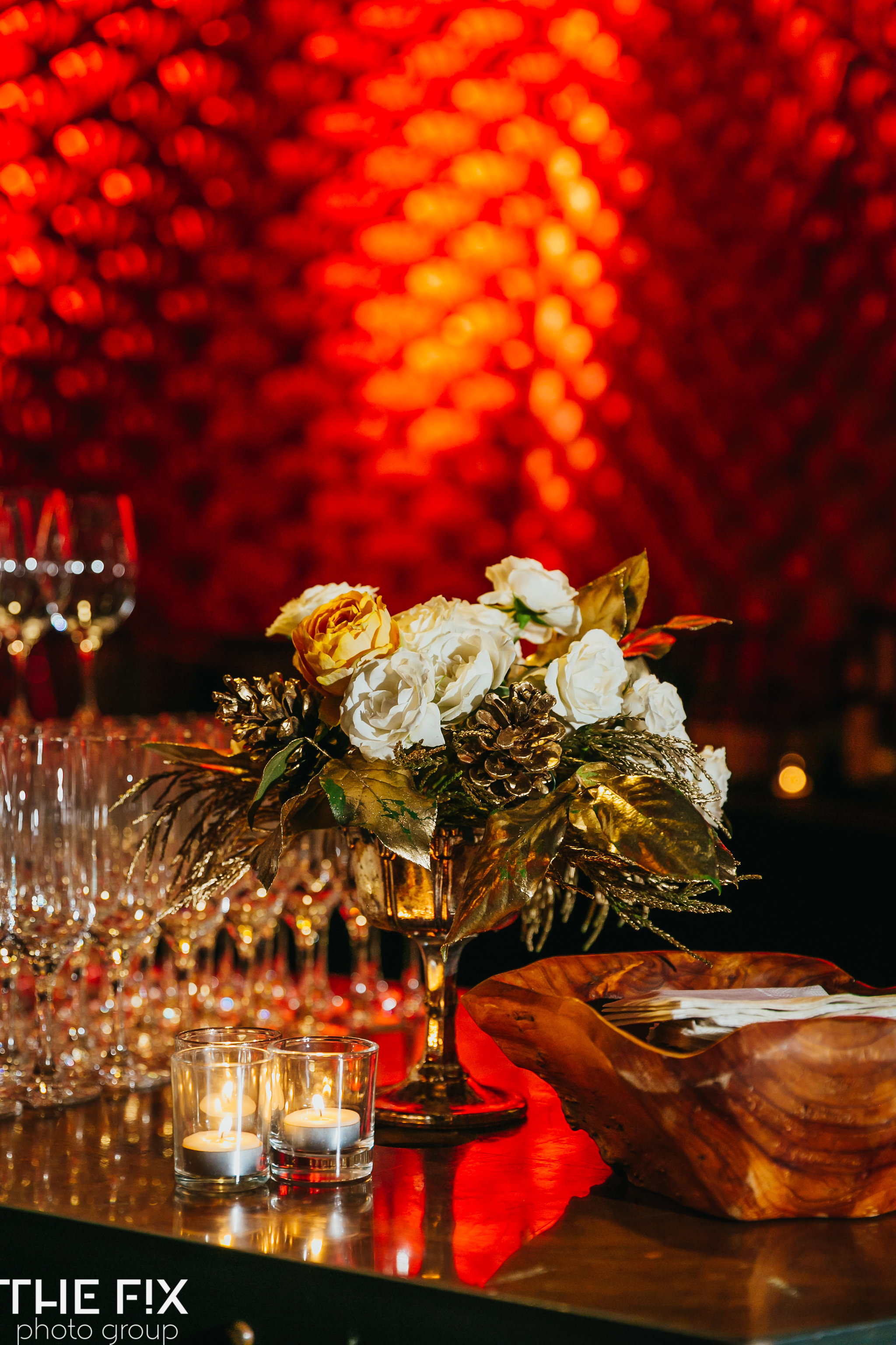 Use uplighting to create a festive ambiance for  Corporate holiday party entertainment at Herban Feast , photographed by the Fix Photo Group
