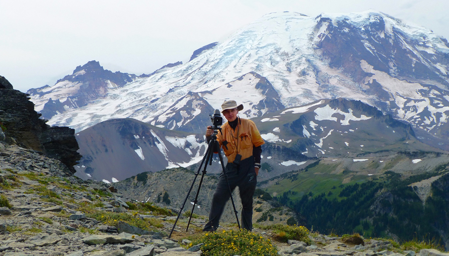 PHOTOGRAPHING THE NORTHEAST FACE OF MOUNT RAINIER, FROM THE SUMMIT                                                                                          OF MOUNT FREMONT
