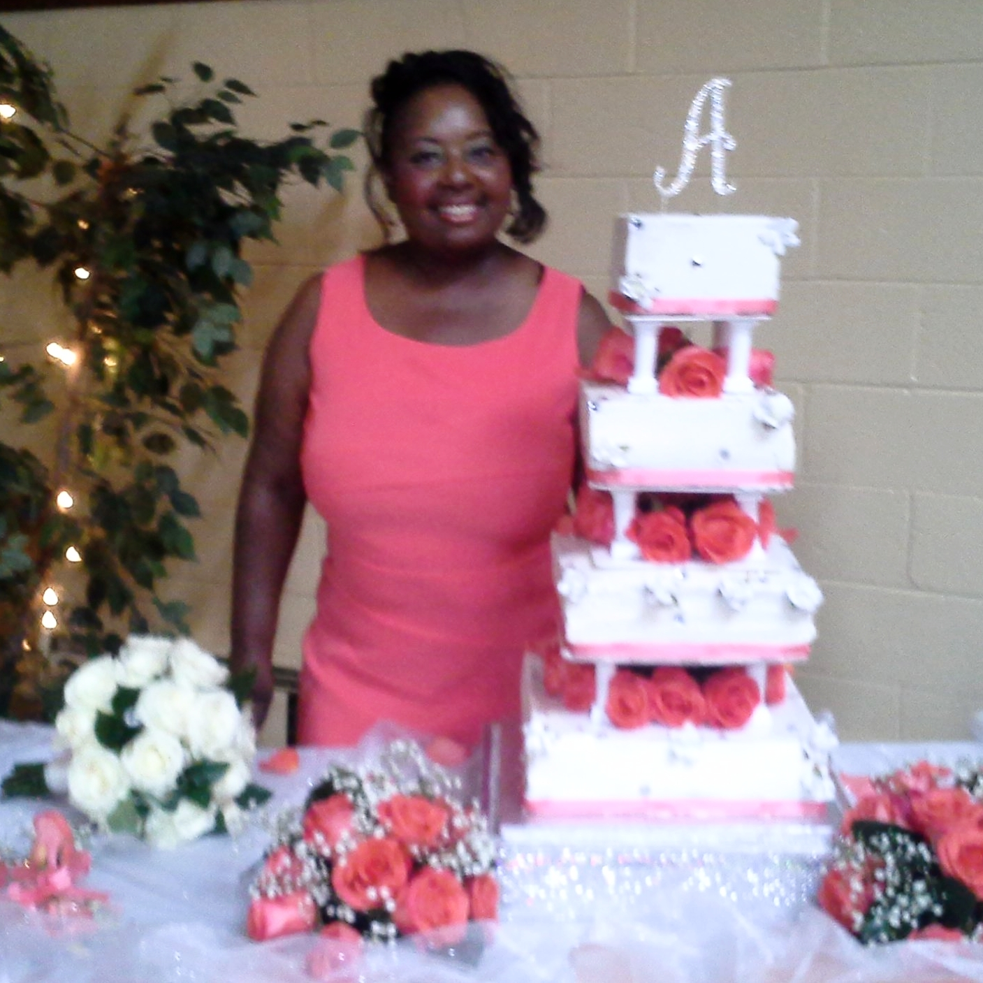 Deborah Brown of Sweetdele's Sweet Treats with wedding cake