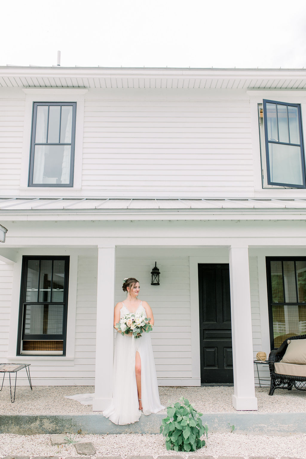 Bride in front of farm house