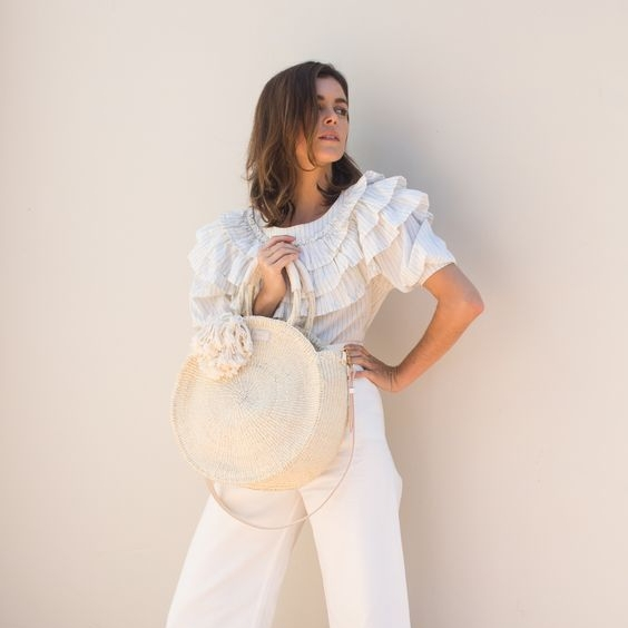 White Theme - Everyone wears White, or another color of choice. simple as that! We love this playful look from Clare V.'s 2016 Spring lookbook.