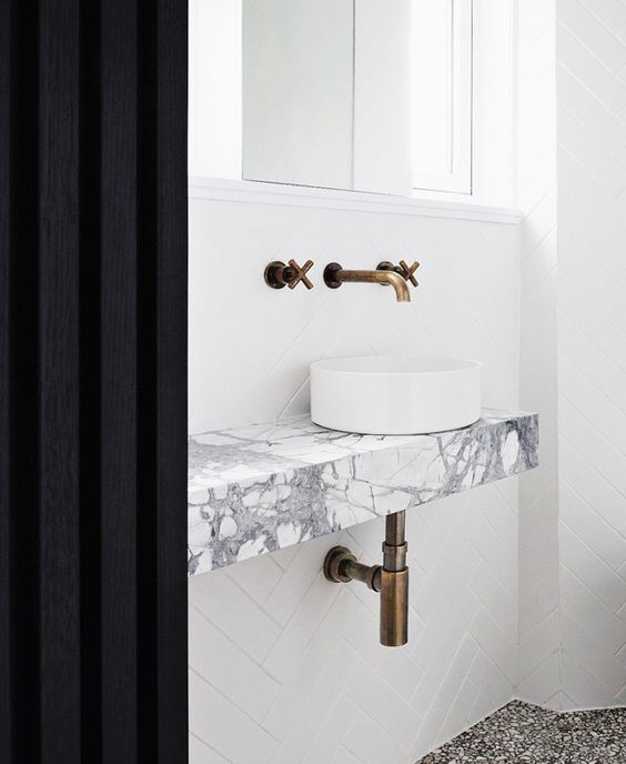 That flooring? …. Brass Gold Tapware, and the marble vanity, if didn't end up doing the concrete.