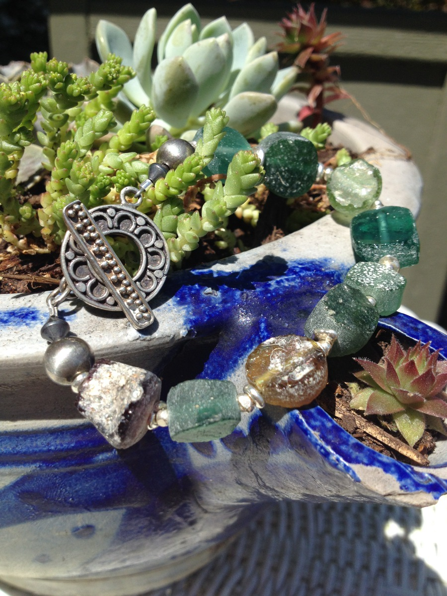 roman glass bracelet with succulents.jpg