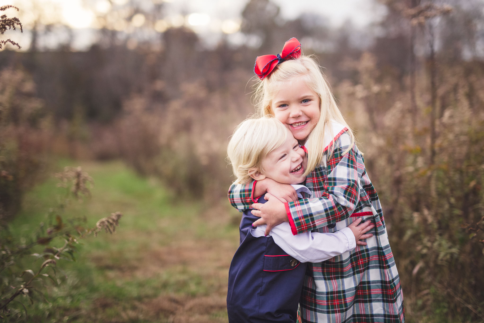 brother sister siblings hugging each other fall family photos thomas wywrot photography nashville photographer