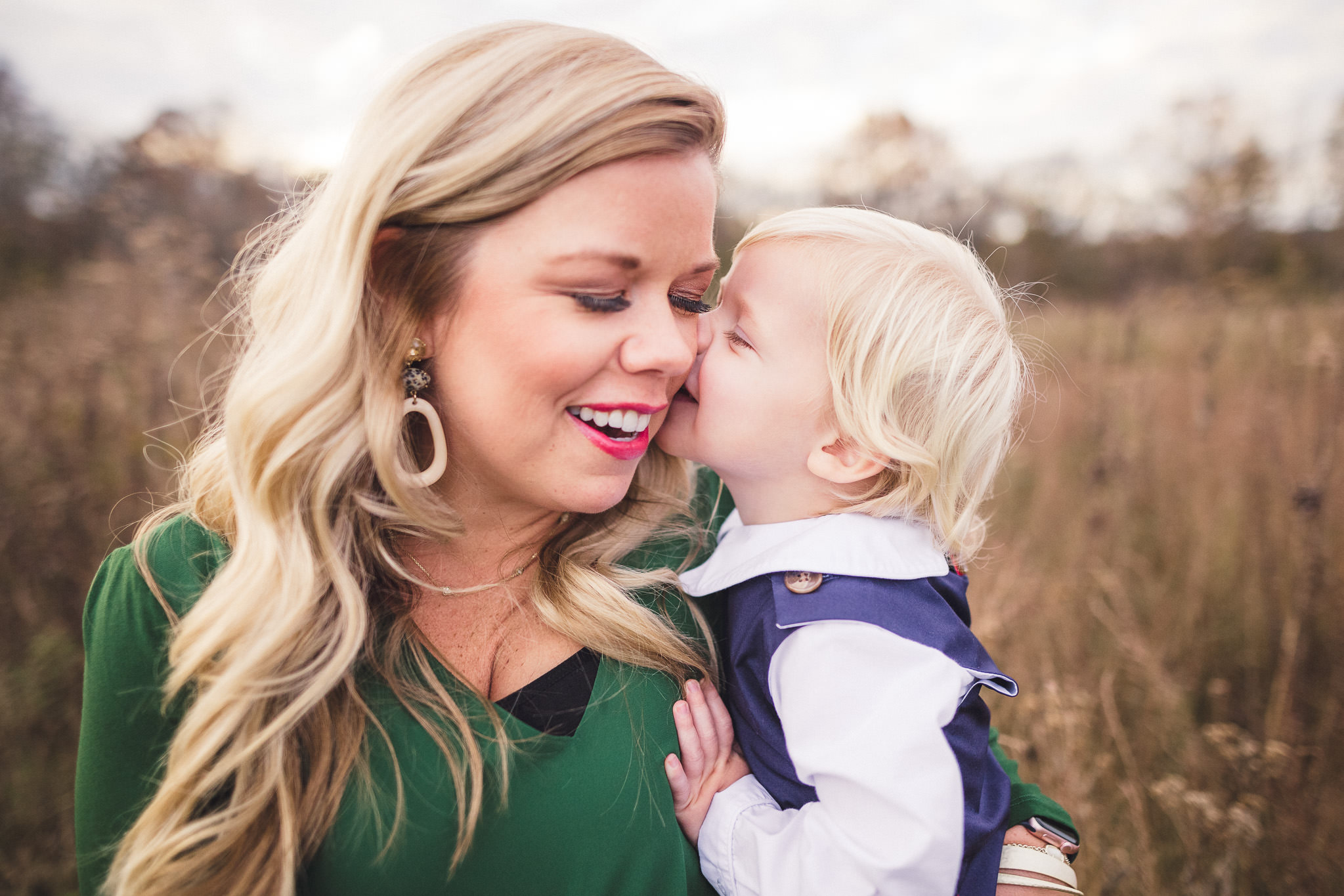 boy kissing mother on cheek smiling fall family photos outdoors nashville photographer thomas wywrot photography