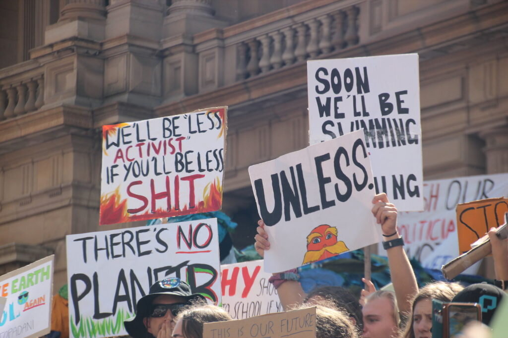 Love when a protest sign just tells it like it is (Credit: Takver via    Flickr   )