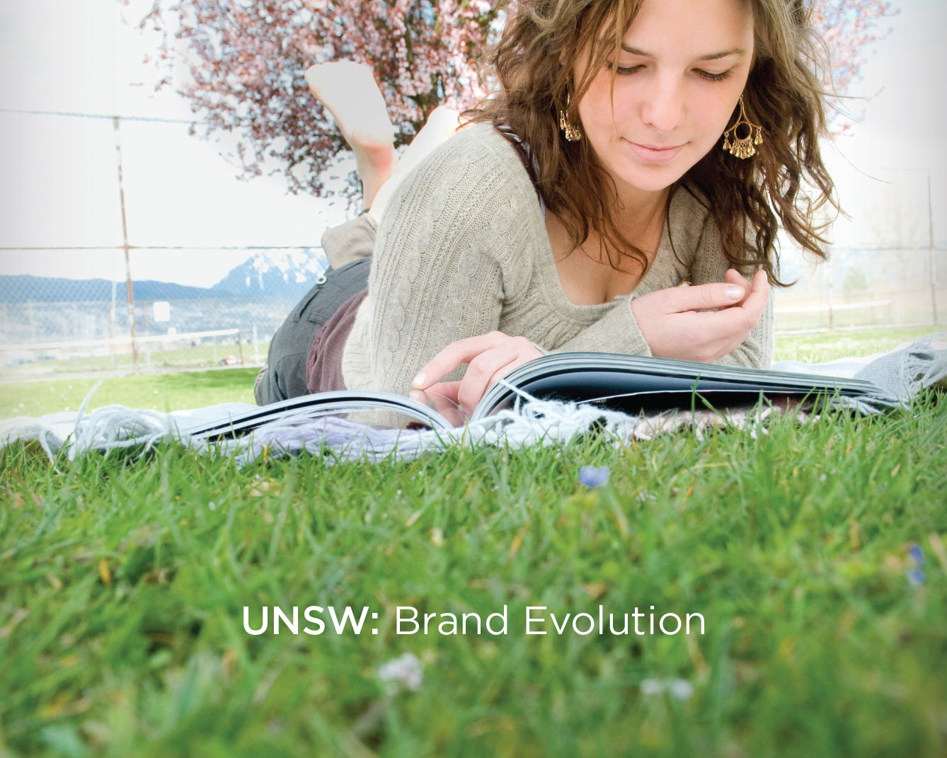 UNSW re-brand poster, woman reading a book