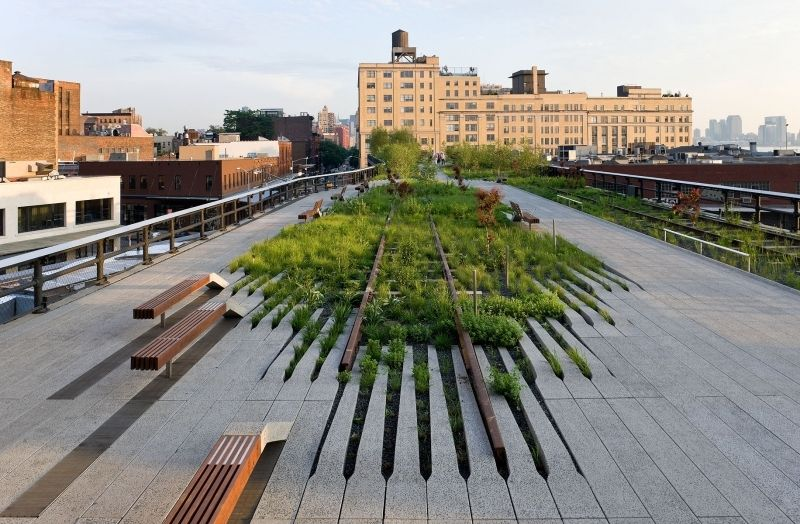 Greenfield development: Two women chat on a patch of grass along the High Line. (Julie Jacobson/AP Photo)