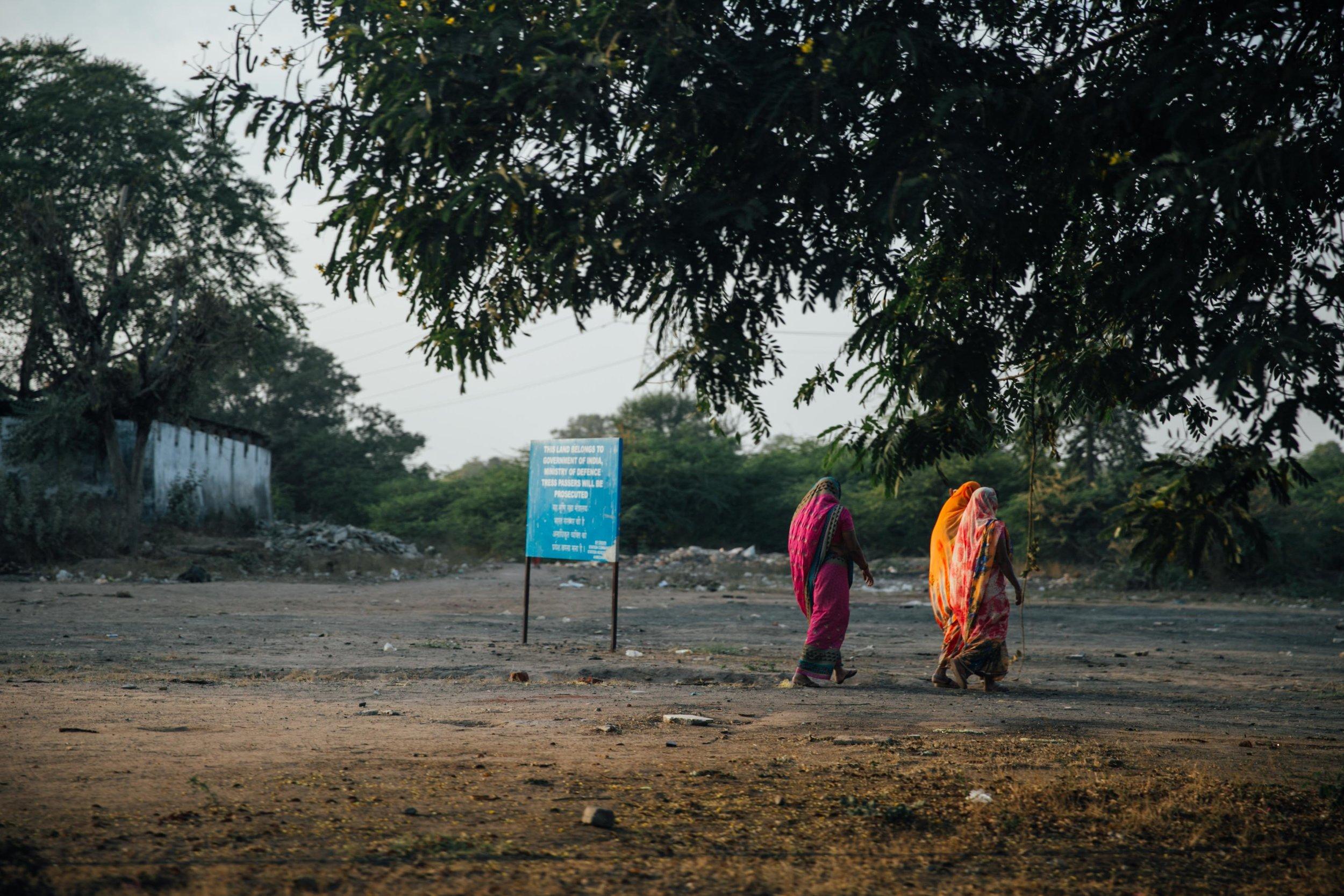 Women walking sunset India
