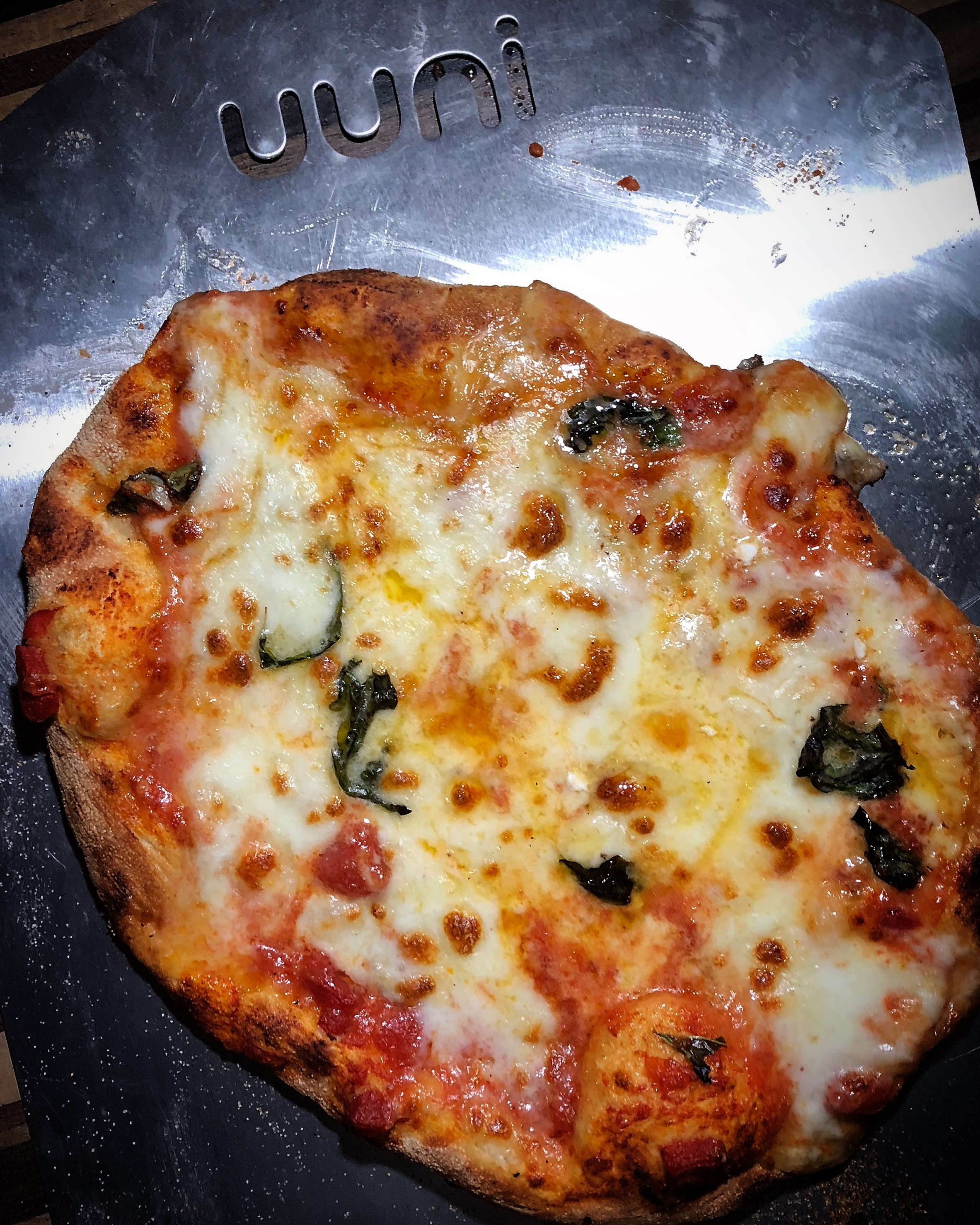 Cooked four cheese pizza.