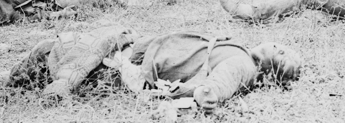 Dead Confederate along the Hagerstown Pike with coverlet blanket.