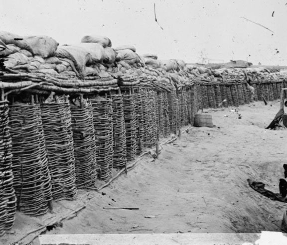 Gabions with stacked sand bags at Fort Sedgwick