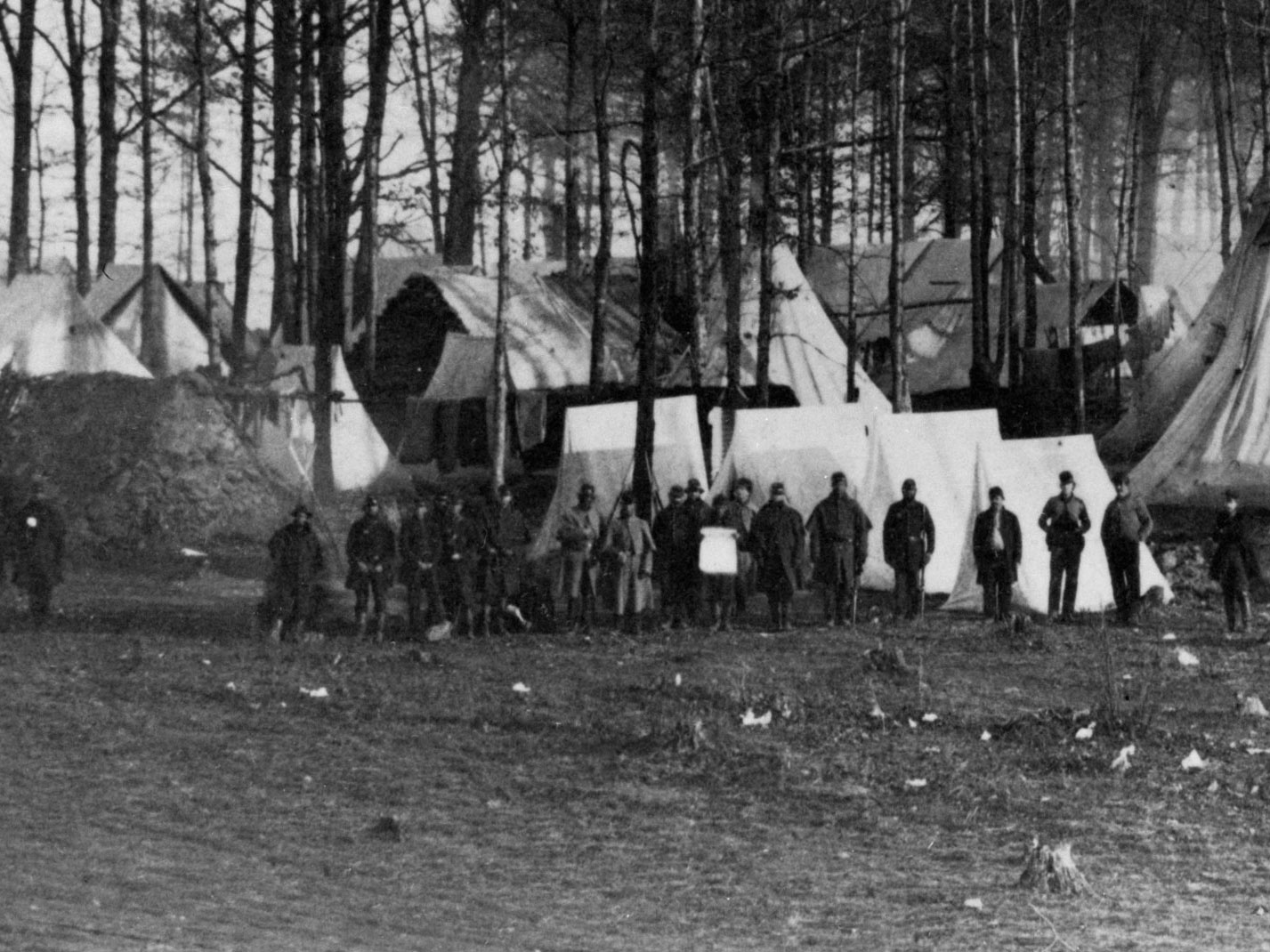 Early Winter, 1862.  2nd Vermont at Camp Griffin, Va. Most of these men are in dark blue pants, with some even in dark blue overcoats. Use the light blue overcoats on two of the men for shade comparisons. (LOC#: LC-USZ62-135917)
