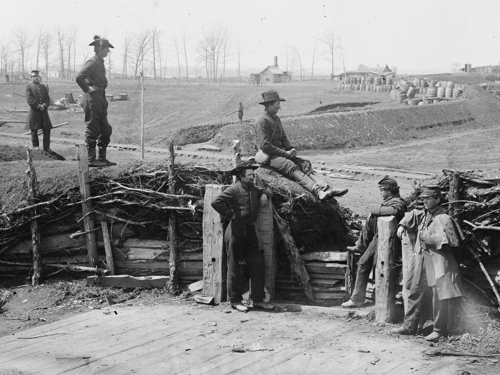 March, 1862.  Confederate fortifications now held by Federal soldiers. It appears as though all six men have dark blue pants. (LOC#: LC-B817-7171)