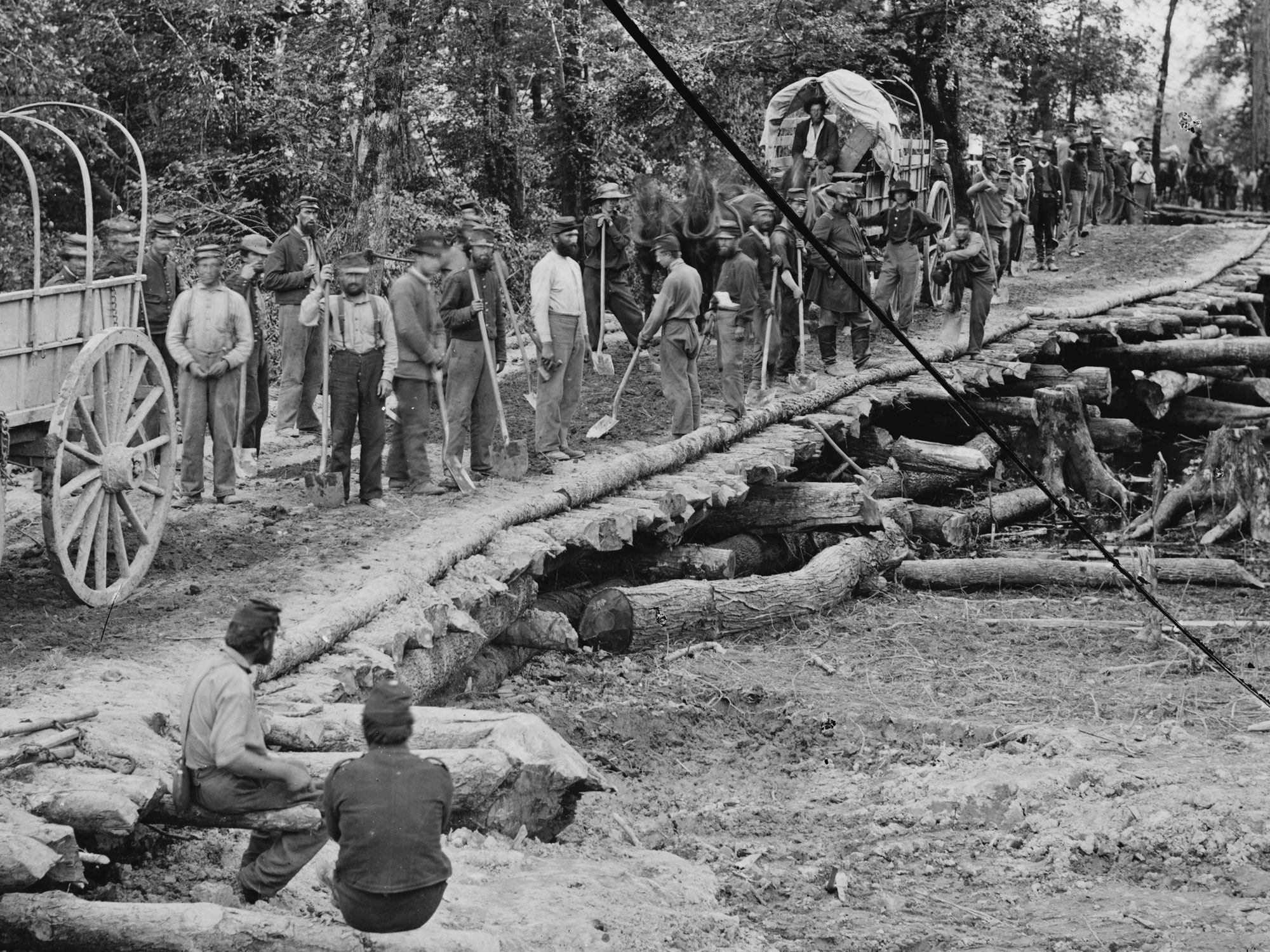 May 27-28, 1862.  Nine memebers of the 5th NH can be seen here in dark blues as they built this bridge across the Chickahominy River, Va. (LOC#: LC-B817-7383)