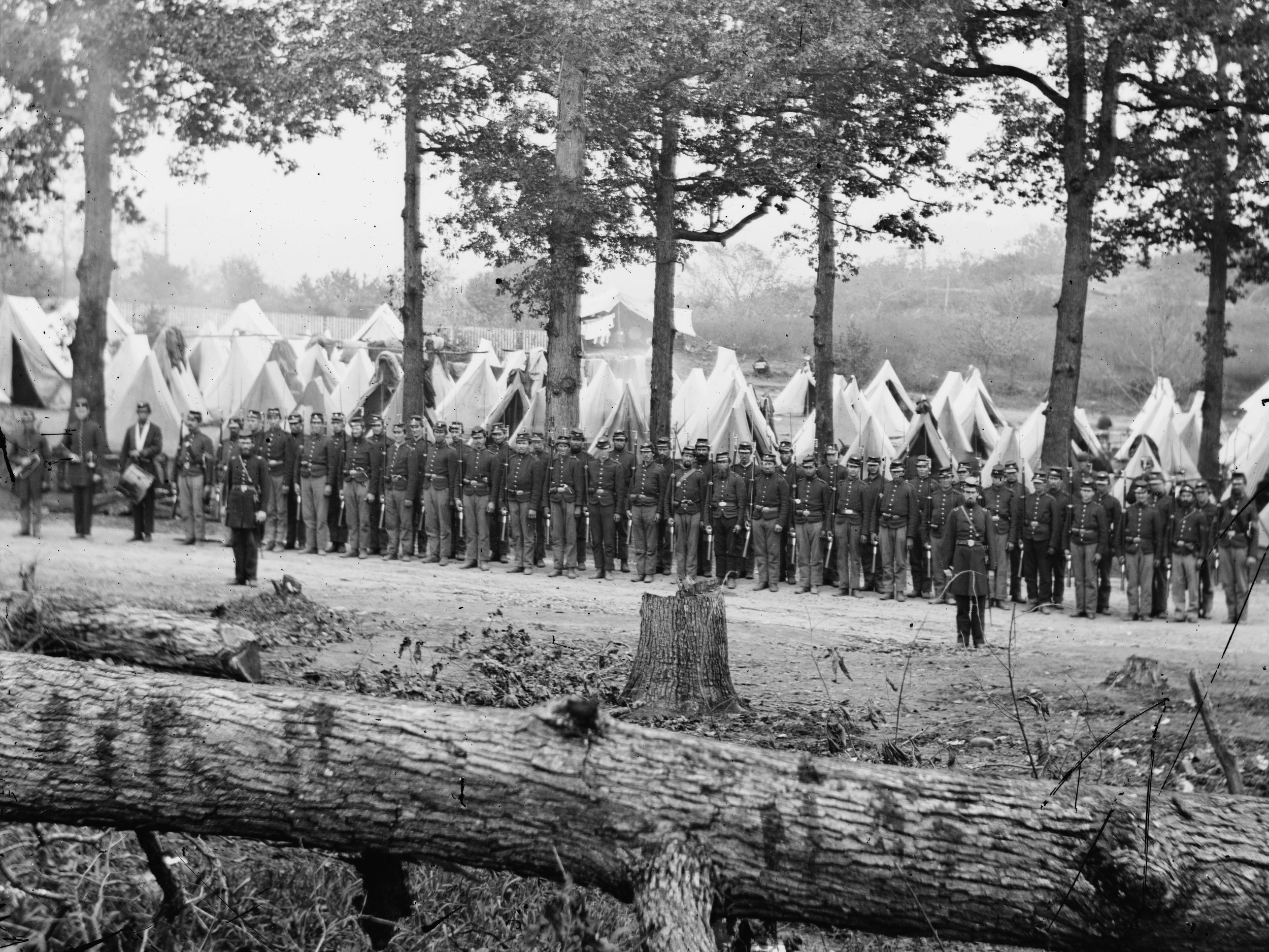 Summer, 1862.   A company of the 35th New York Infantry shows an even mix of pant colors. Notice the rear rank is comprised solely of men in dark blues, perhaps arranged like this for the photograph. (LOC#: LC-B811-2422)