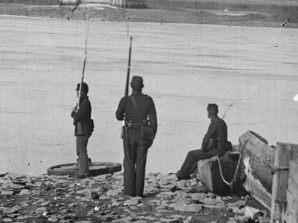 Summer/Fall, 1862.  Coosaw Ferry, Port Royal Island, SC. Still transitioning to sky blues, two of these three men are wearing dark blues while on guard duty. (LOC#: LC-B811-201)