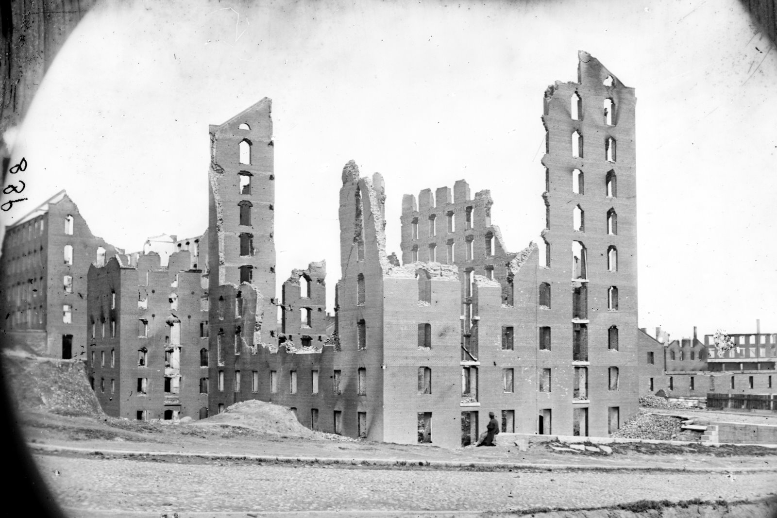 Gallego Mills in 1865. The ruins of the of 9-story 1848 mill are seen on the left of the image, behind the newer 12-story mill. (27)