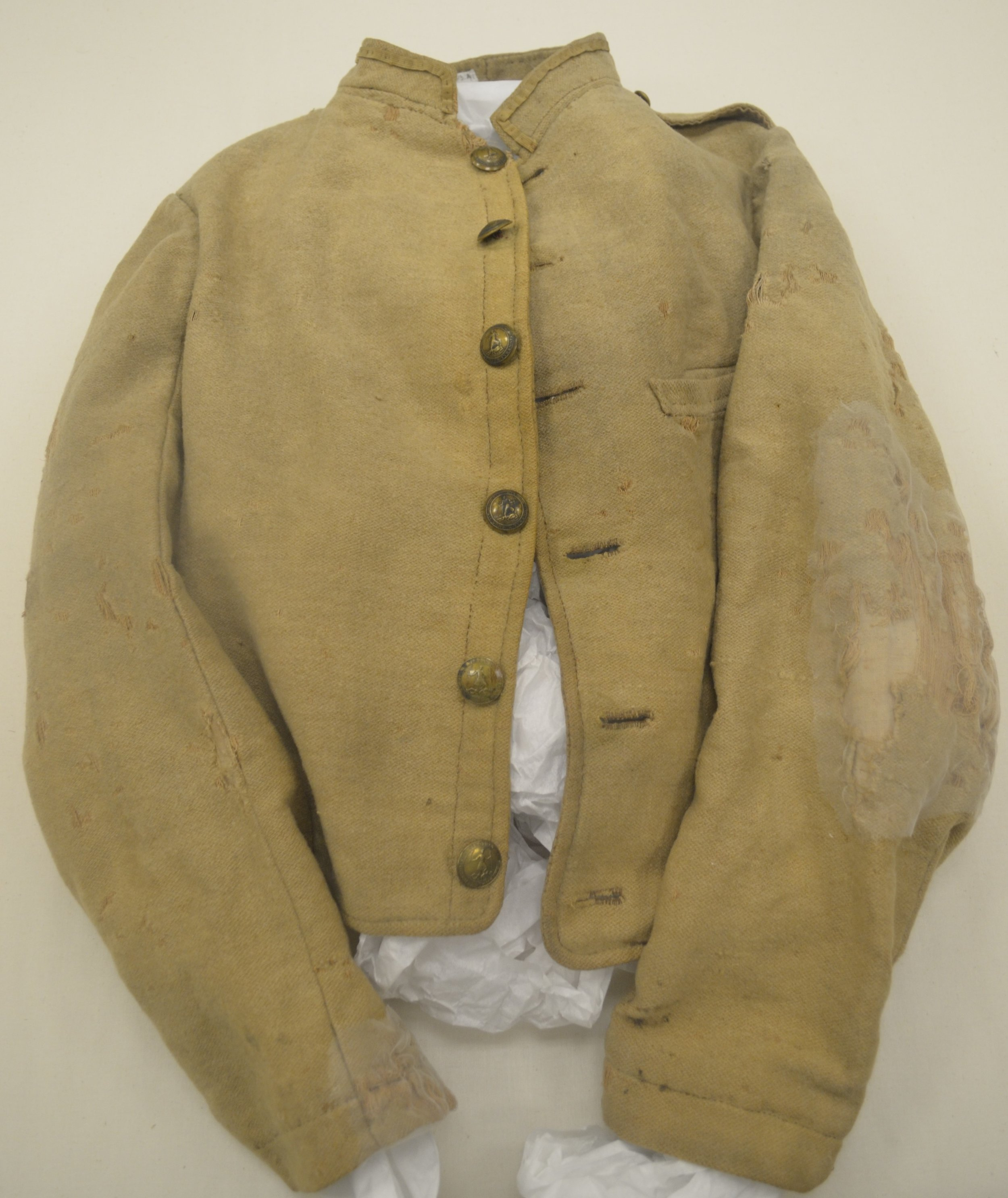 Figure 3 - Jacket in Atlanta History Center captured in Union raid on CS Depot, Dublin, VA in May 1864. Note the extensive damage to the left arm. Collection Atlanta History Center (Atlanta, Georgia). Author's Photograph.