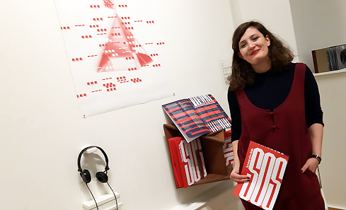 Artist and Programmer Sarah Calmus next to work SOS at the Royal Scottish Academy for the SSA Annual Exhibition.