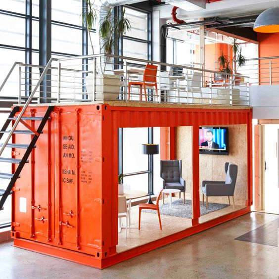 shipping container breakout area at 99c's office by Inhouse Brand Architects