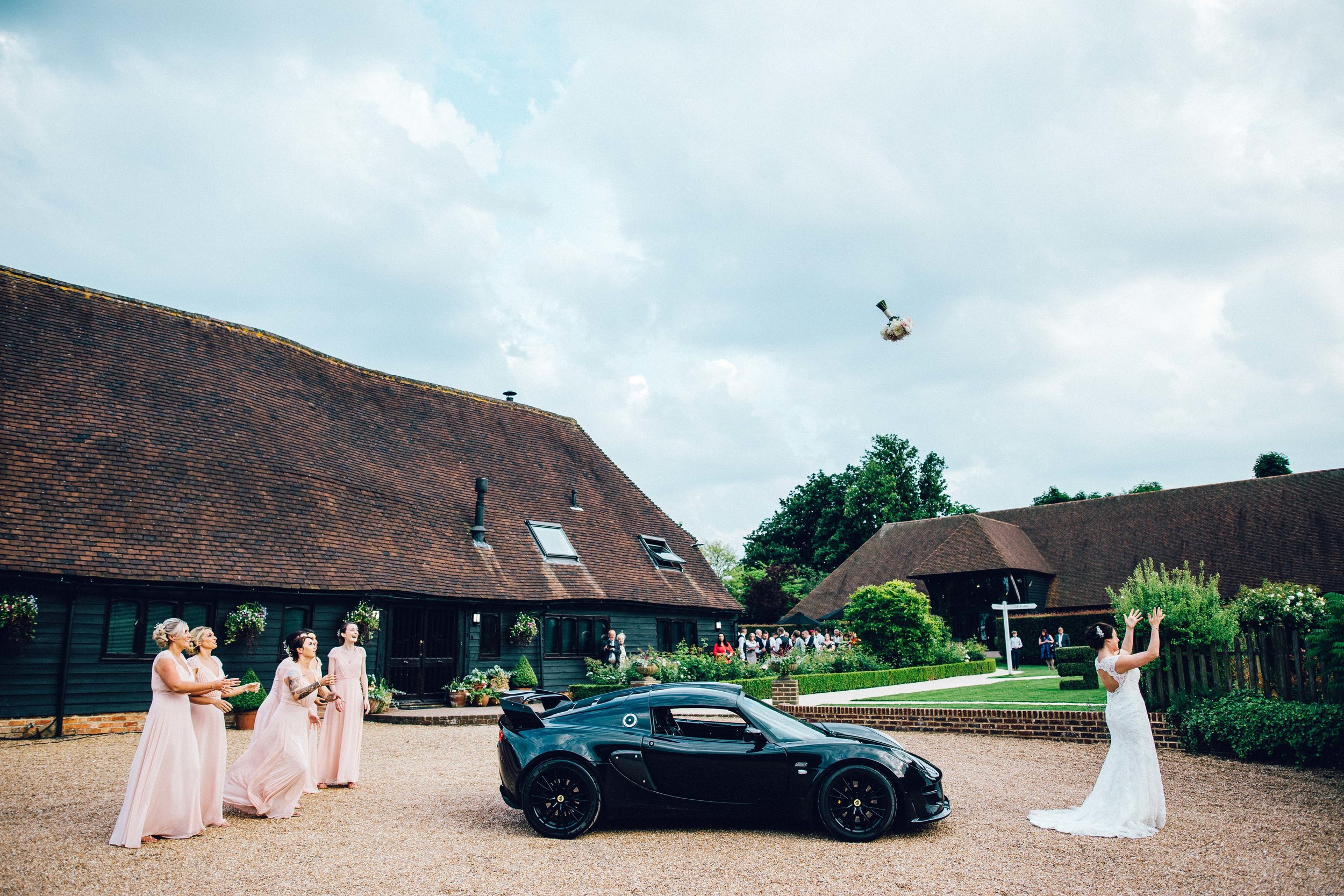 Bouquet throwing over a sports car!