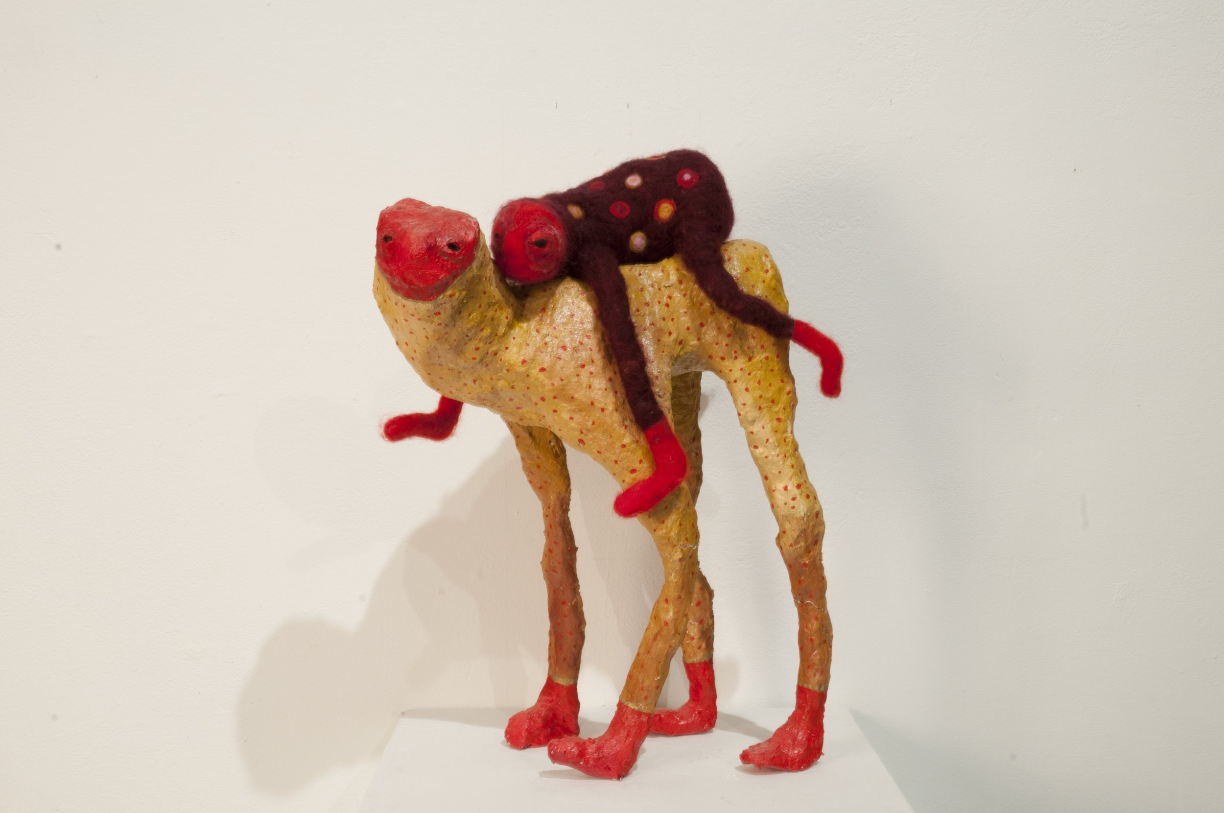 Burden in Red Boots (2018)  Paper mache and needle felted wool.