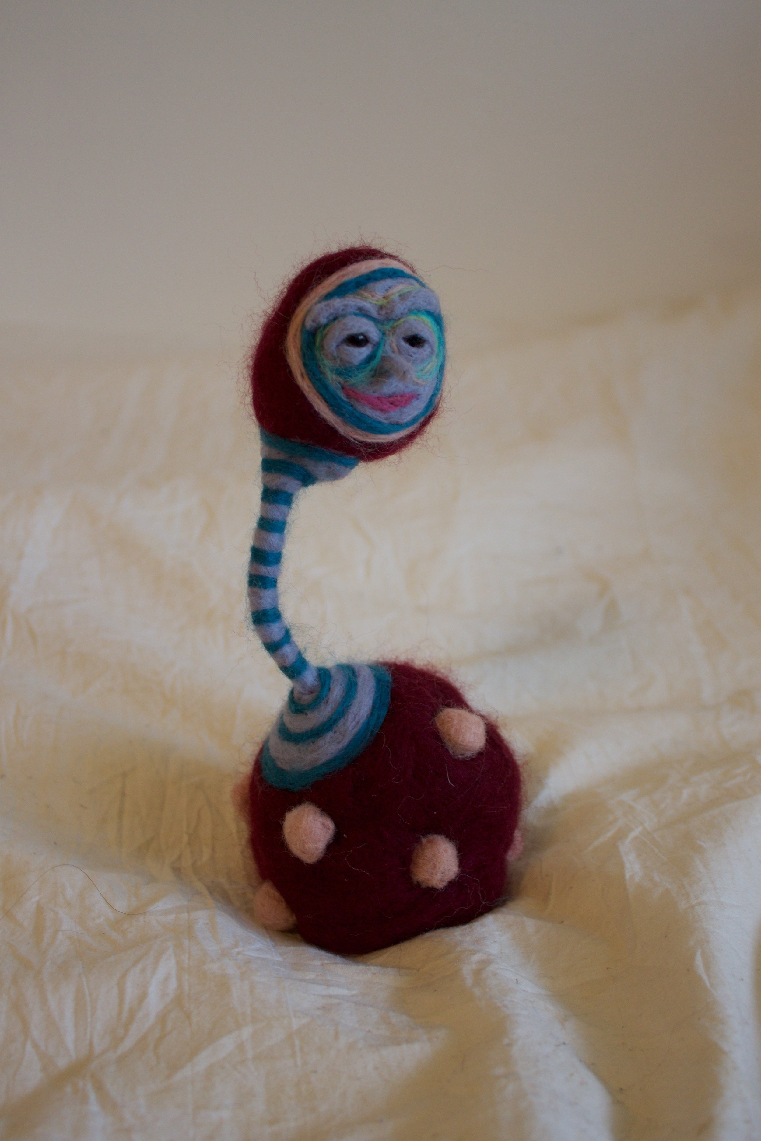 Balance Just Right  Wool roving, polyfil, glass eyes, wire