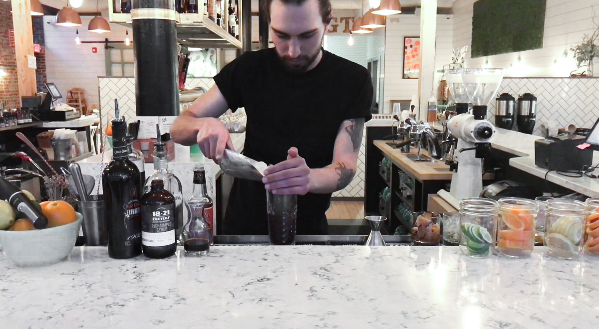 VIDEO STILL: Bartender Mike Schrader mixing up a  Lord Byron , feat. Tinker Coffee.