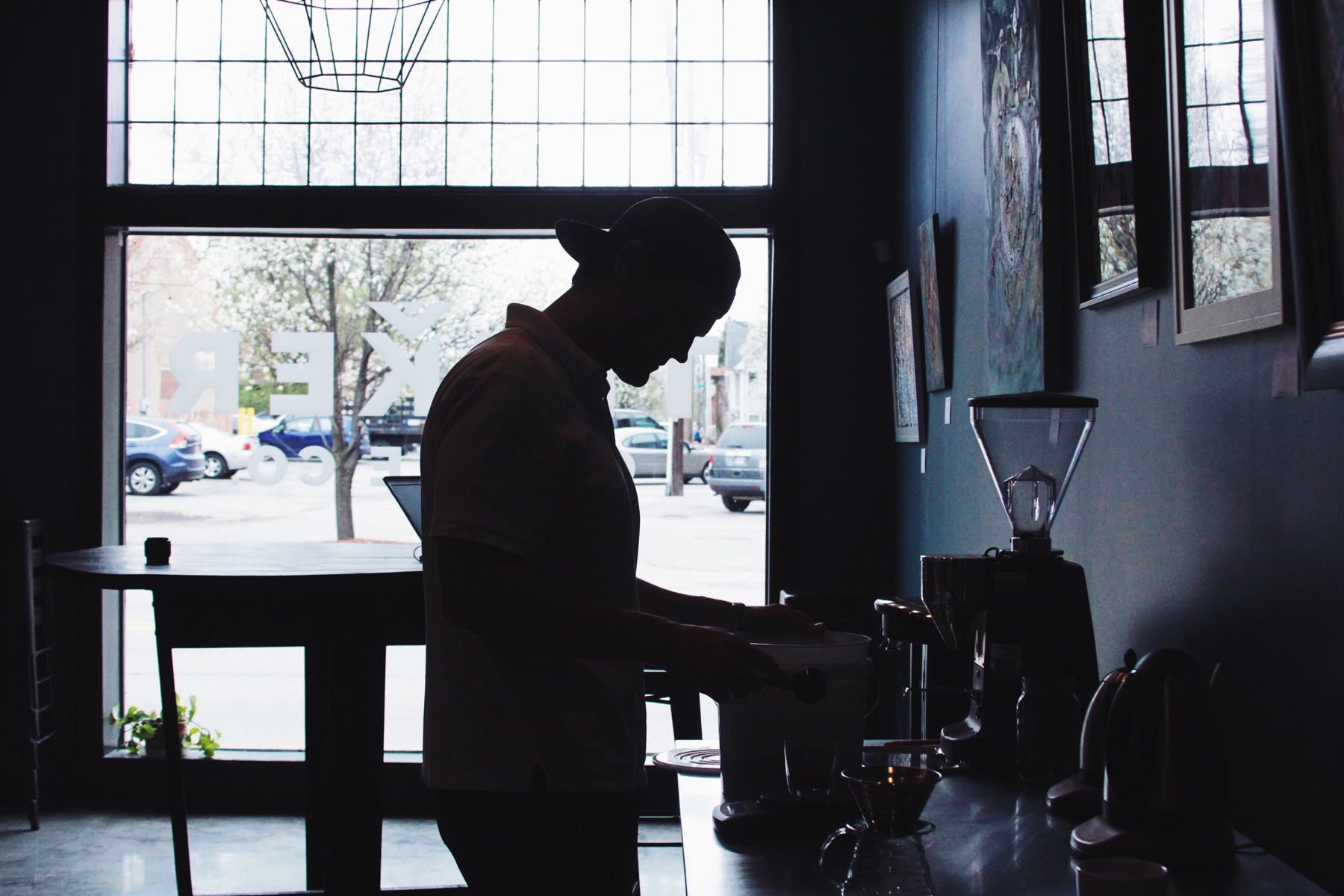 Tinker's Steven Hall weighing out coffee at the roastery.