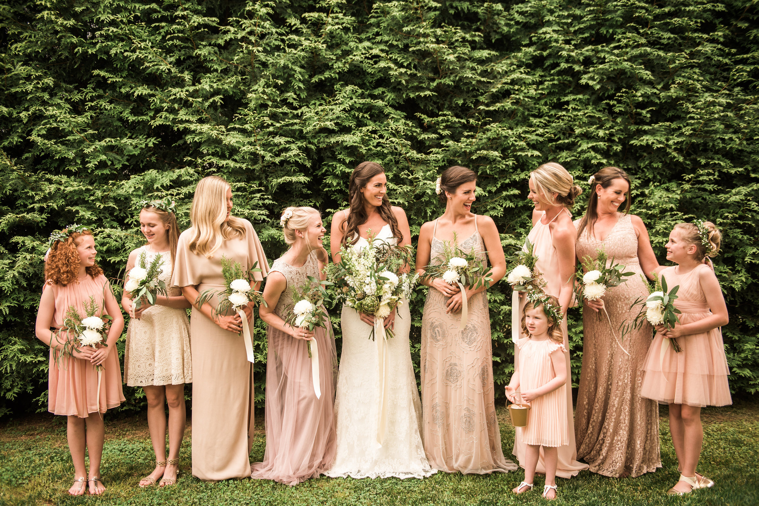 A Green and White Romantic Boho Wedding. A unique green and white, loose wildflower bridal bouquet with artichoke focal. Bridesmaids carrying small bouquets of greenery, herbs and white flowers.   Flowers by Flower Buds   Photograph by Heart and Oak Photography   Venue The Ruins at Kellum Valley Farm