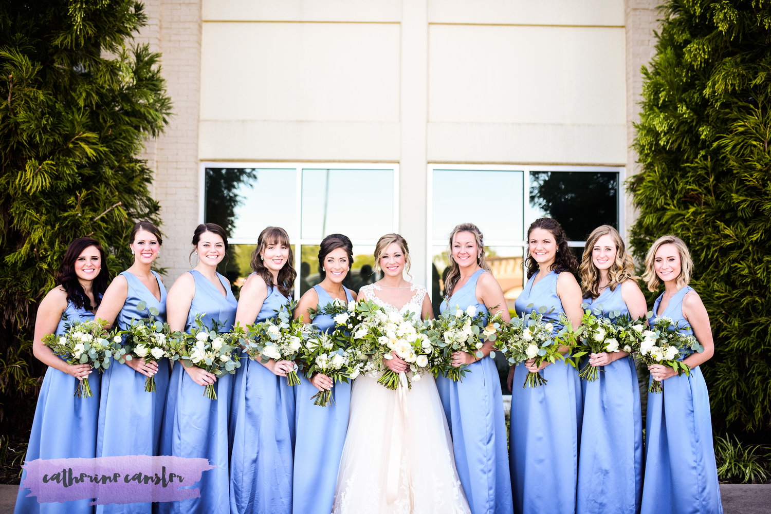 Loose and romantic bouquets of white and green.   Flowers by Flower Buds. Photo by Catherine Cansler Photography