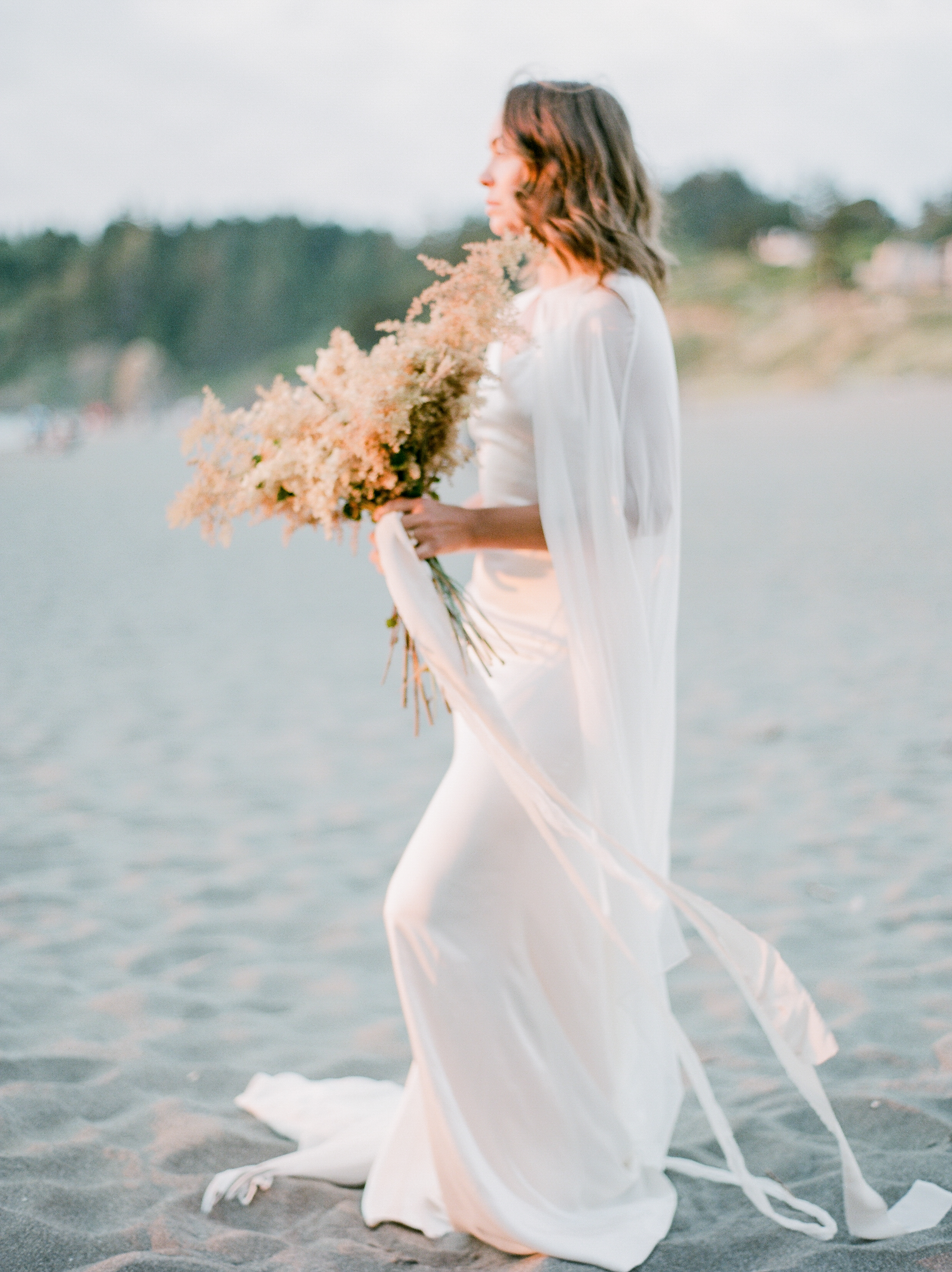 "The sea allows us a moment to escape. To feel free from the burdens that we carry. A lightness comes over us and we are taken to a place and time where our souls can be free. A place where our hearts open to love and life's infinite possibilities. Today's beautiful Beach Wedding editorial, captured by  Madalina Sheldon , has this sentiment perfectly captured. Full of light and softness, this shoot inspires both our minds and our hearts!  Joywed    ""This shoot was all about the textures, tones and contrast of the capricious summers of California's Lost Coast. I wanted to put together a scene that is full of movement and light, adorned with handmade details and florals foraged from bushes and dry plants that grow right around the beach where we shot"". A. Ambrosini"