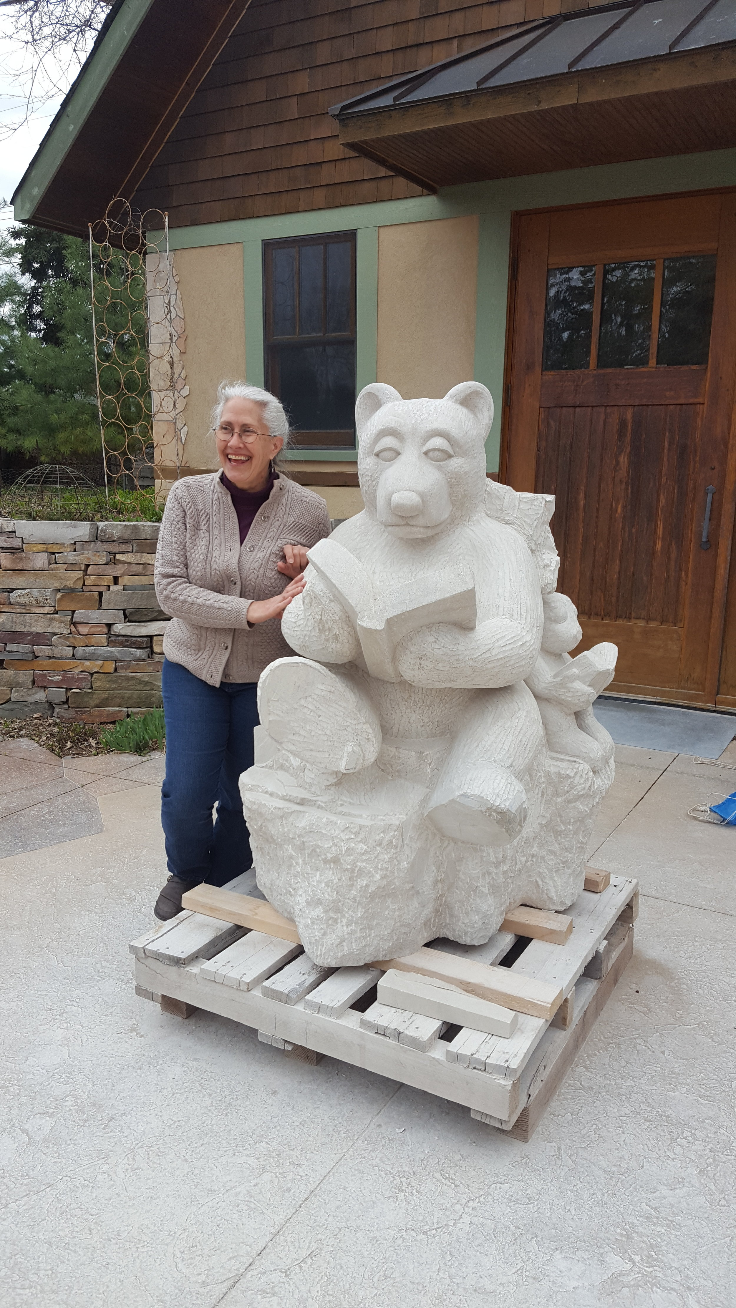 "Janey Westin, outside her studio, with the work-in-progress ""Bear and Bunny"" sculpture for the Edina Library."