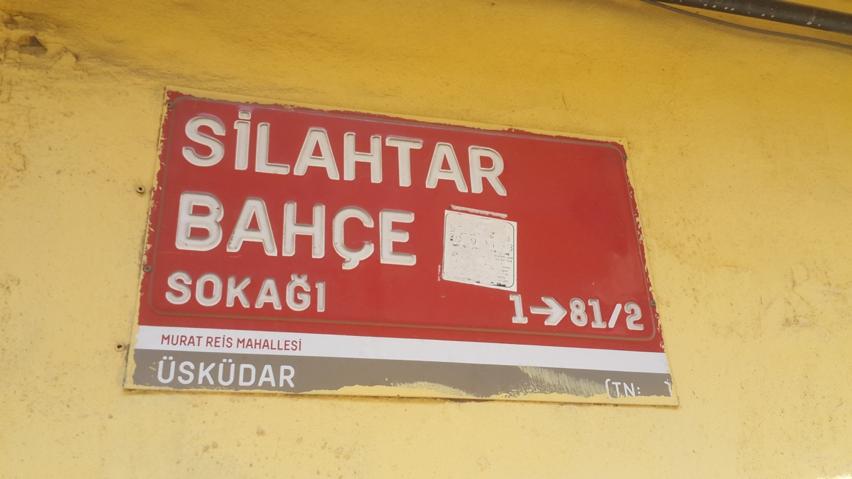 "Sign: ""The Gardens of Silihdar."""