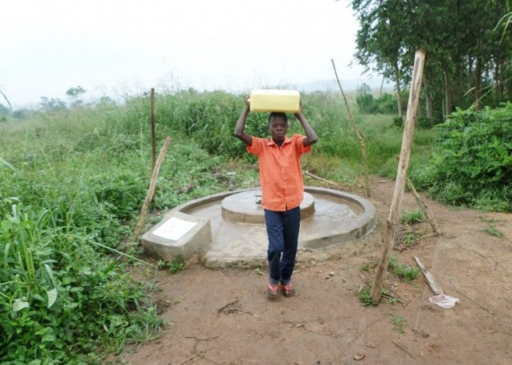 Lawrence-Carrying-water-back-home-e1449748416335-570x407.jpg