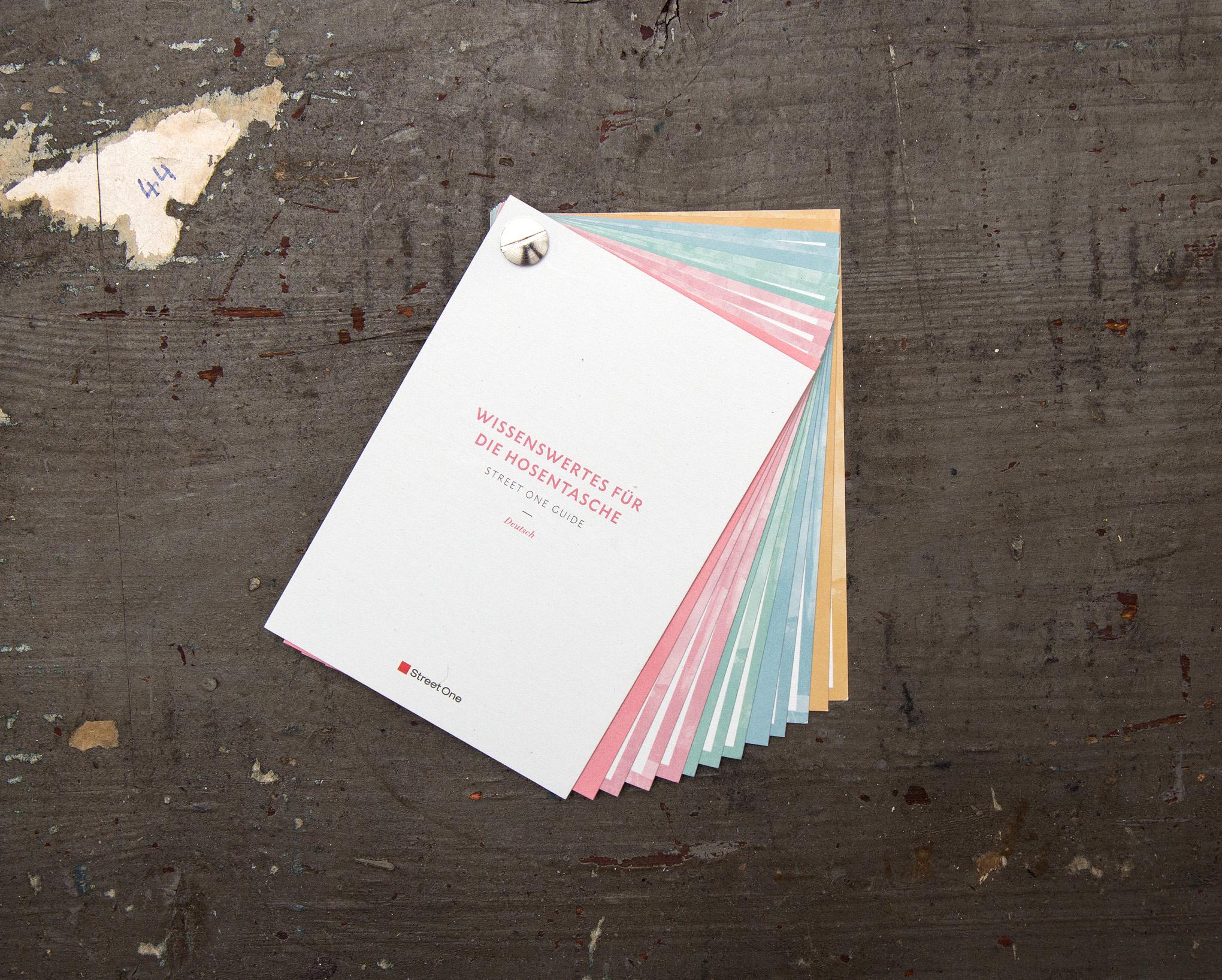 Gestaltung (sons of ipanema) eines Pocket Guides für Street One mit Aquarellflächen und Typografie.
