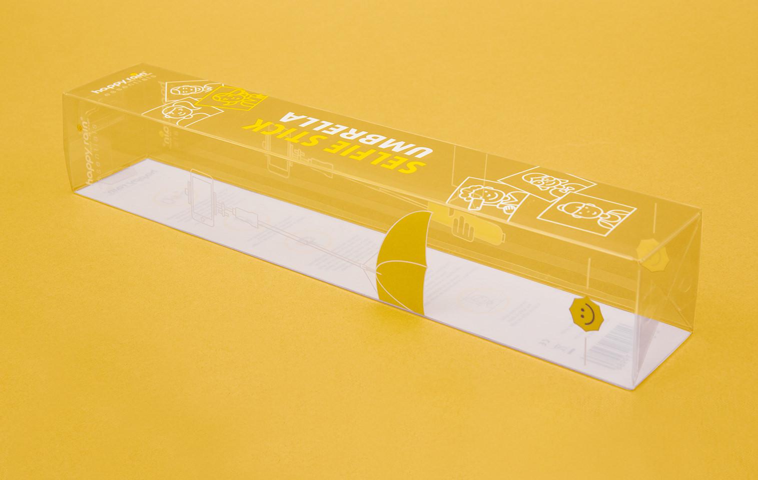 leere Verpackung des happy rain Selfie Stick Umbrella / transparente Verpackung mit Siebdruck in Gelb und Weiß, Agentur: sons of ipanema / Cologne