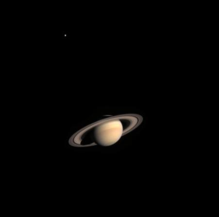Saturn and one of its moons.