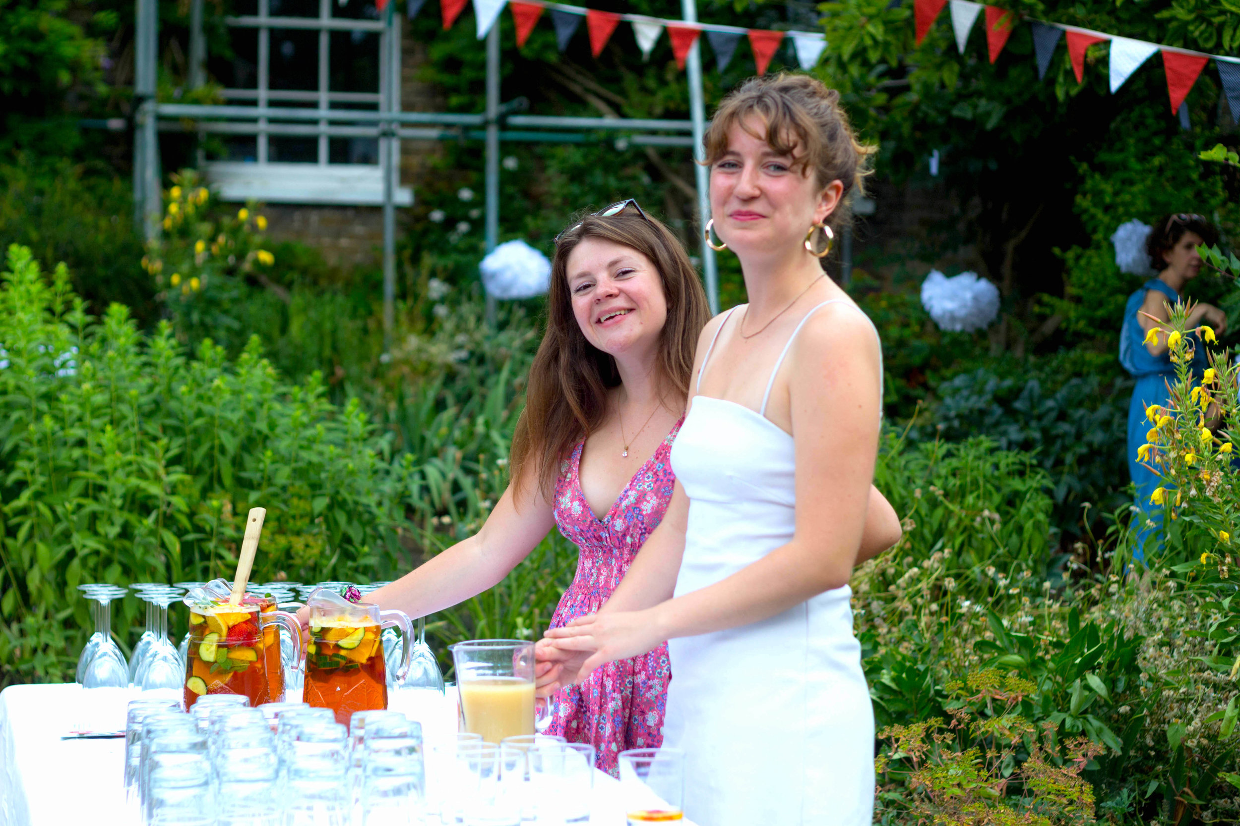 Helpers serving drinks at the annual Volumteers Summer Party at Bell House