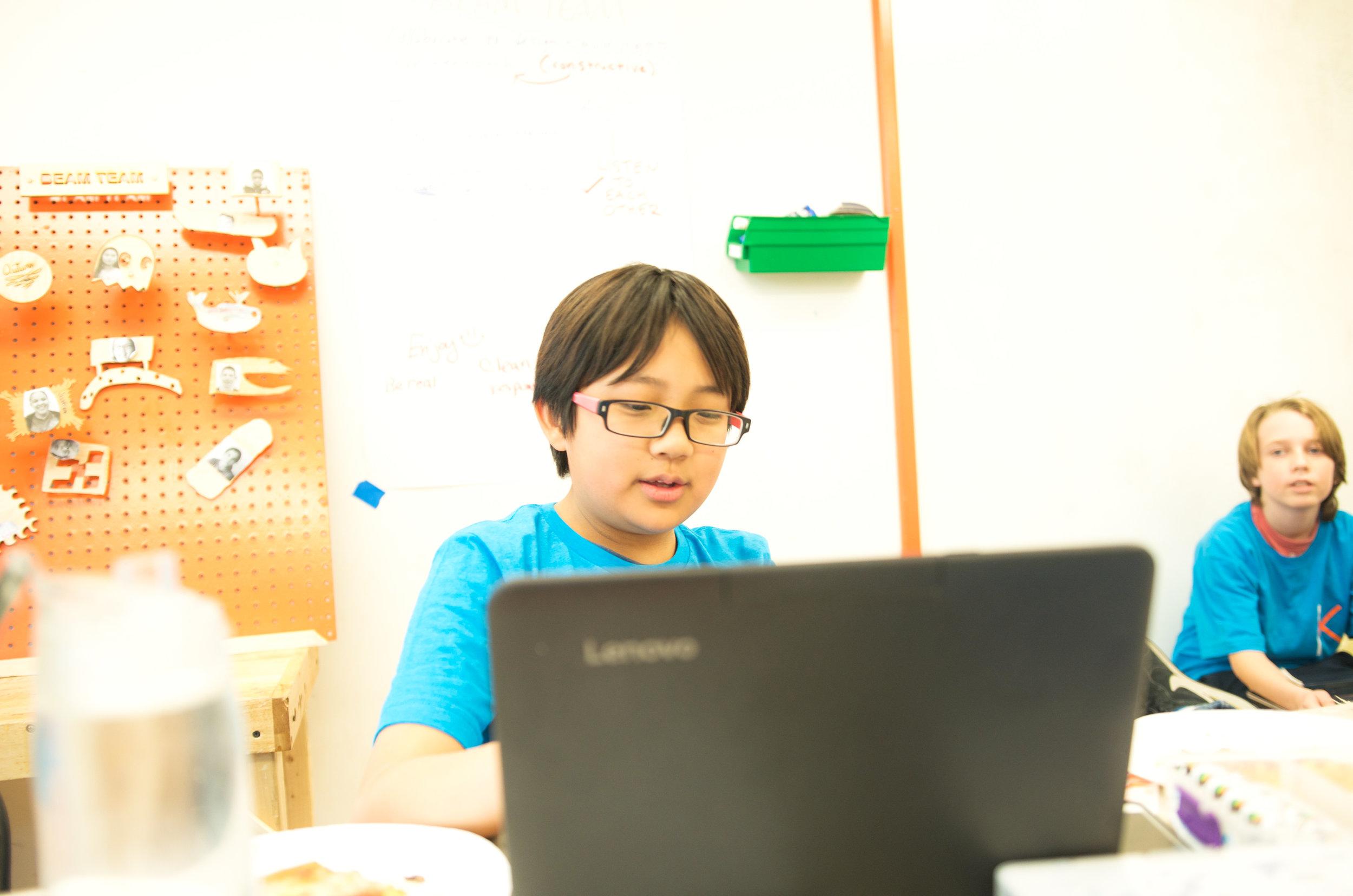 Student Coding Website on Laptop